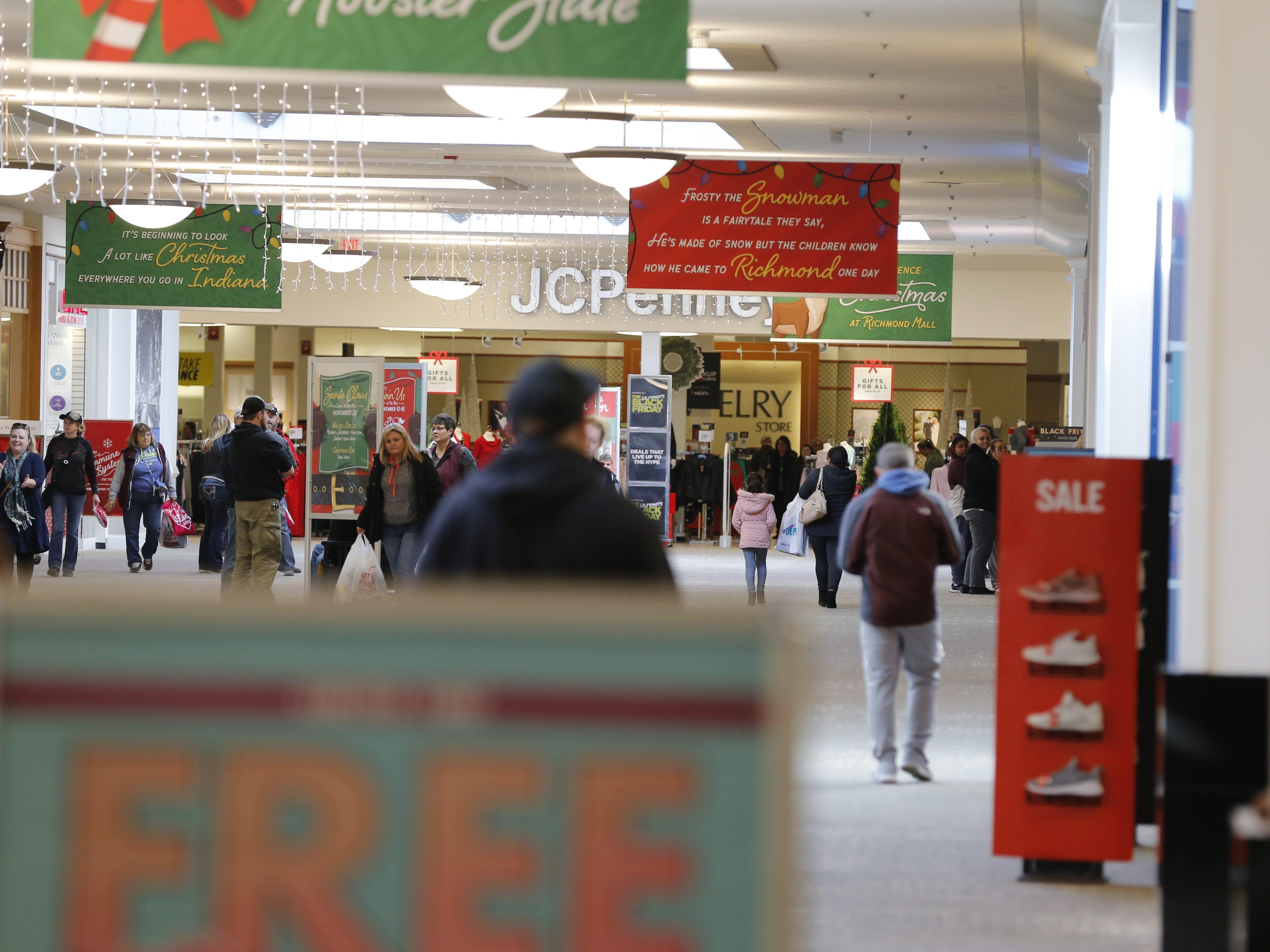 Shoppers make their way through the Richmond Mall to take advantage of Black Friday deals on Nov. 23, 2018.