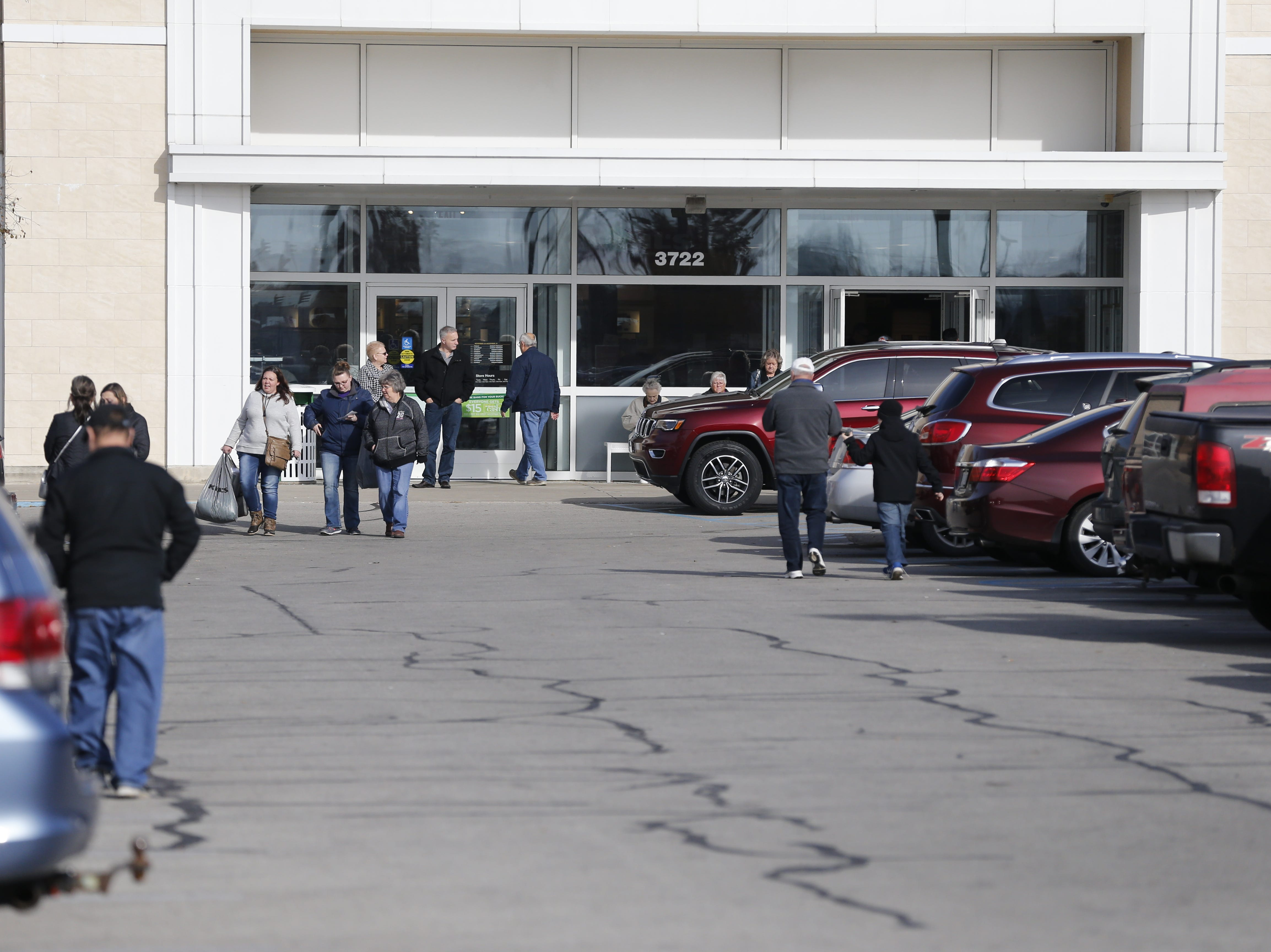 The parking lots for Dick's Sporting Goods, Best Buy, Kohl's, Menards and other east-side Richmond retailers were packed Friday morning, Nov. 23, 2018.