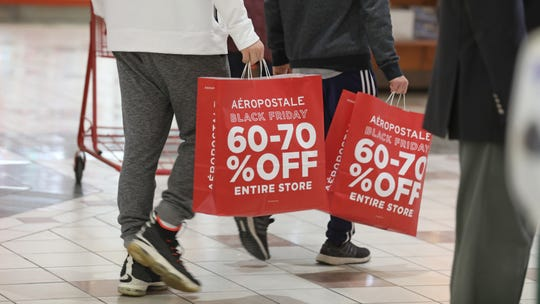 Unique sales and specials brought shoppers out during the annual Black Friday shopping day at Eastview Mall in Victor Friday, Nov. 23, 2018.