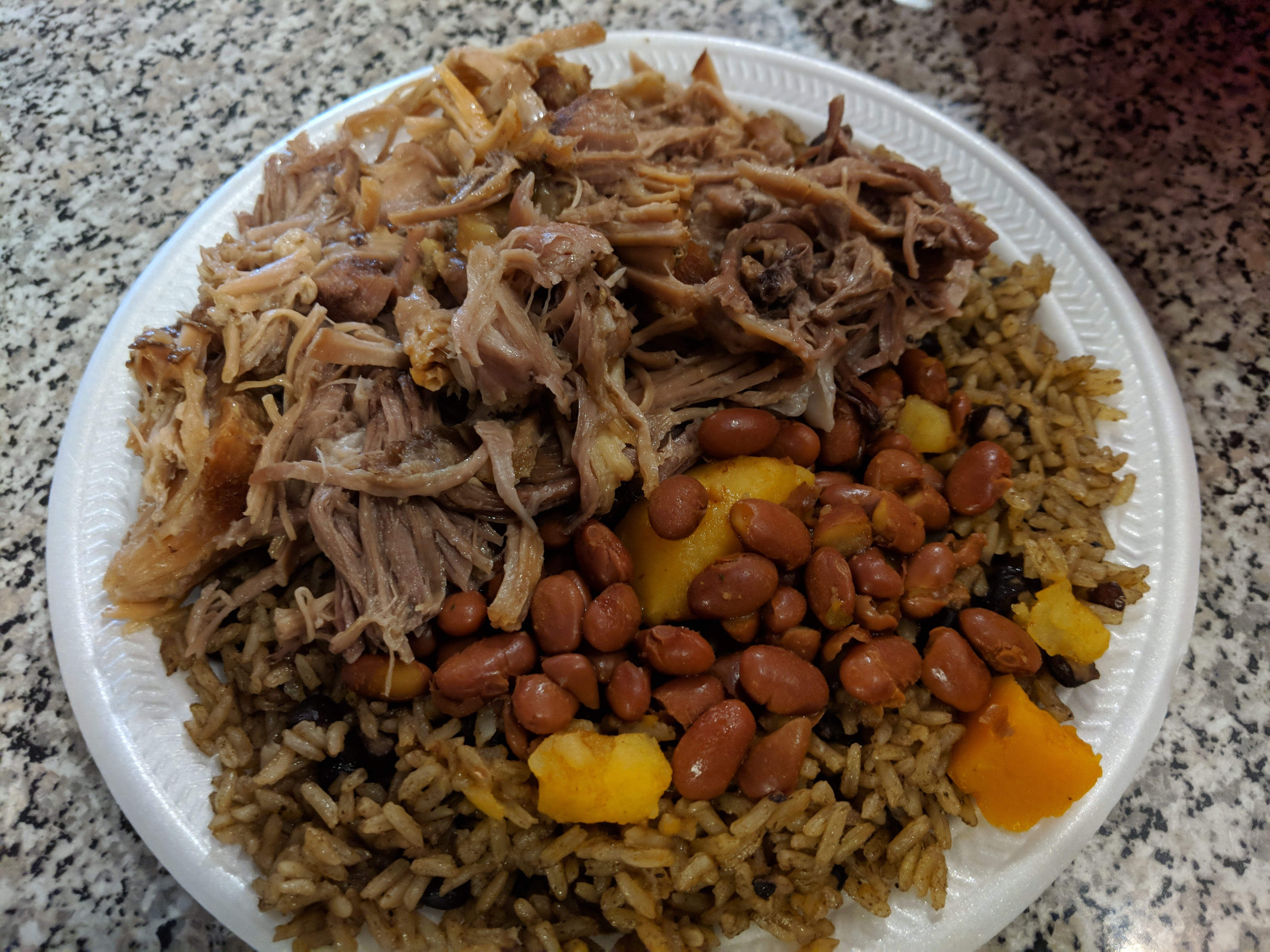 Pernil (roast pork) with rice and beans at La Olla Criolla.