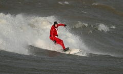 How does Santa get to Rochester? On a surfboard, of course