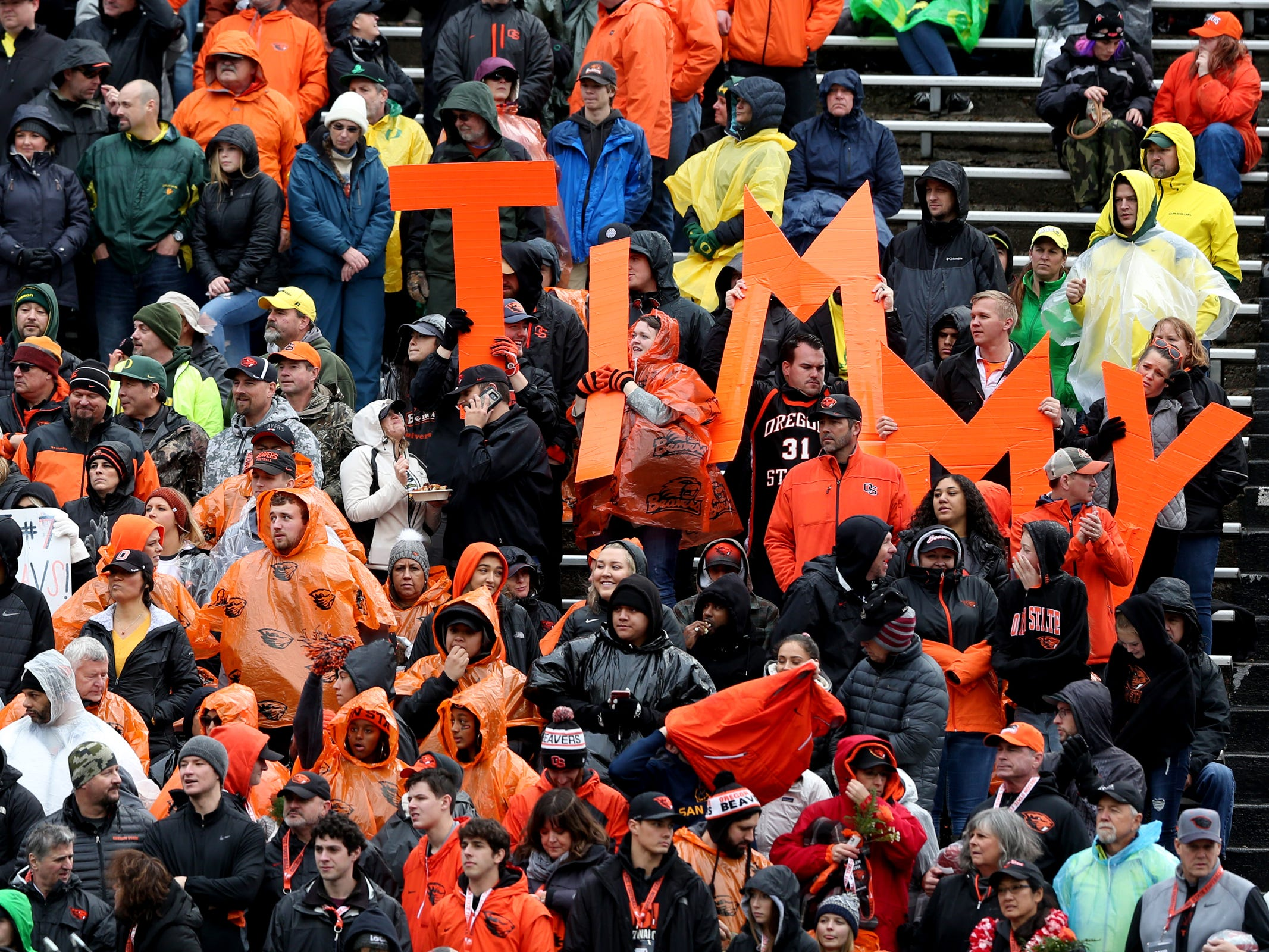 Fans cheer on Oregon State's Timmy Hernandez (18) in the Oregon vs. Oregon State Civil war football game at Oregon State University in Corvallis on Friday, Nov. 23, 2018.