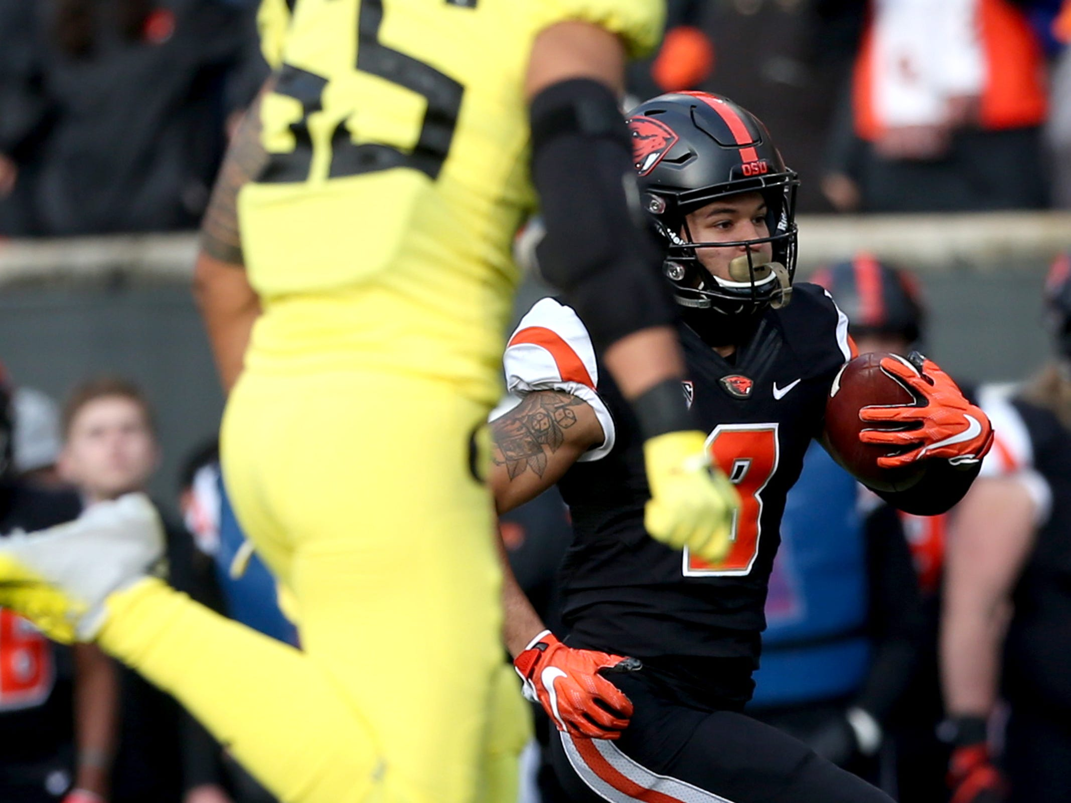 Oregon State's Trevon Bradford (8) rushes in the Oregon vs. Oregon State Civil war football game at Oregon State University in Corvallis on Friday, Nov. 23, 2018.