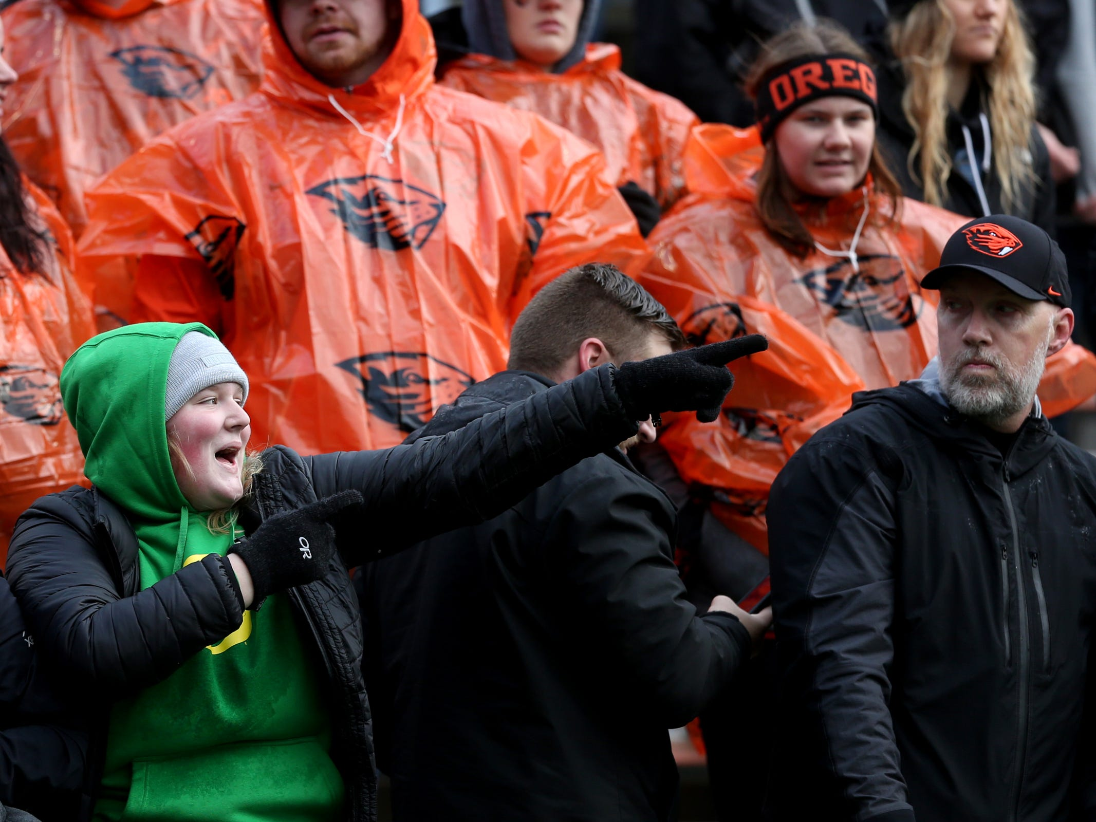 Oregon and Oregon State fans react to a play in the Oregon vs. Oregon State Civil war football game at Oregon State University in Corvallis on Friday, Nov. 23, 2018.