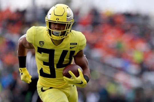 Oregon's CJ Verdell (34) rushes in the Oregon vs. Oregon State Civil war football game at Oregon State University in Corvallis on Friday, Nov. 23, 2018.