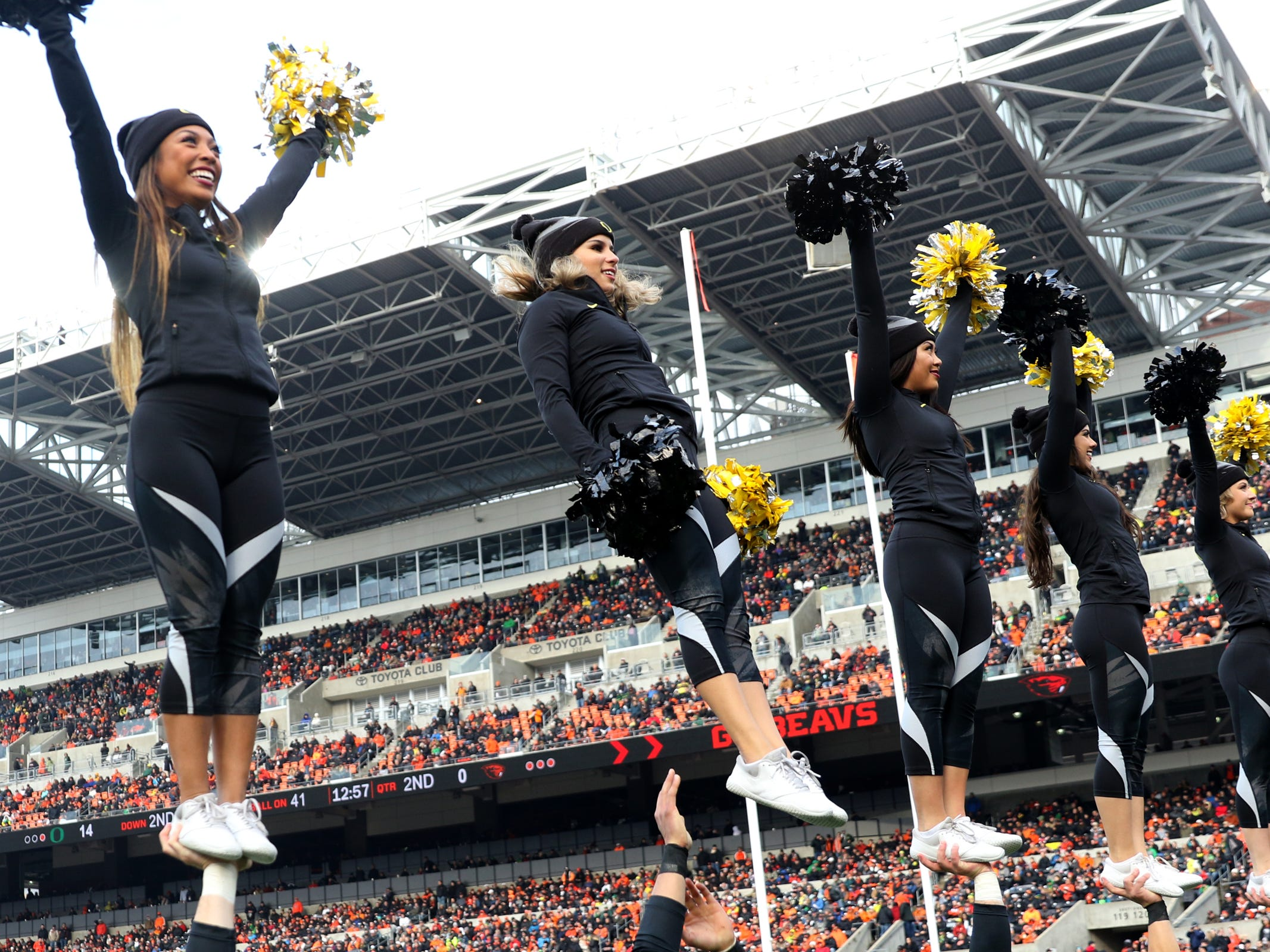 Oregon cheerleaders perform in the Oregon vs. Oregon State Civil war football game at Oregon State University in Corvallis on Friday, Nov. 23, 2018.