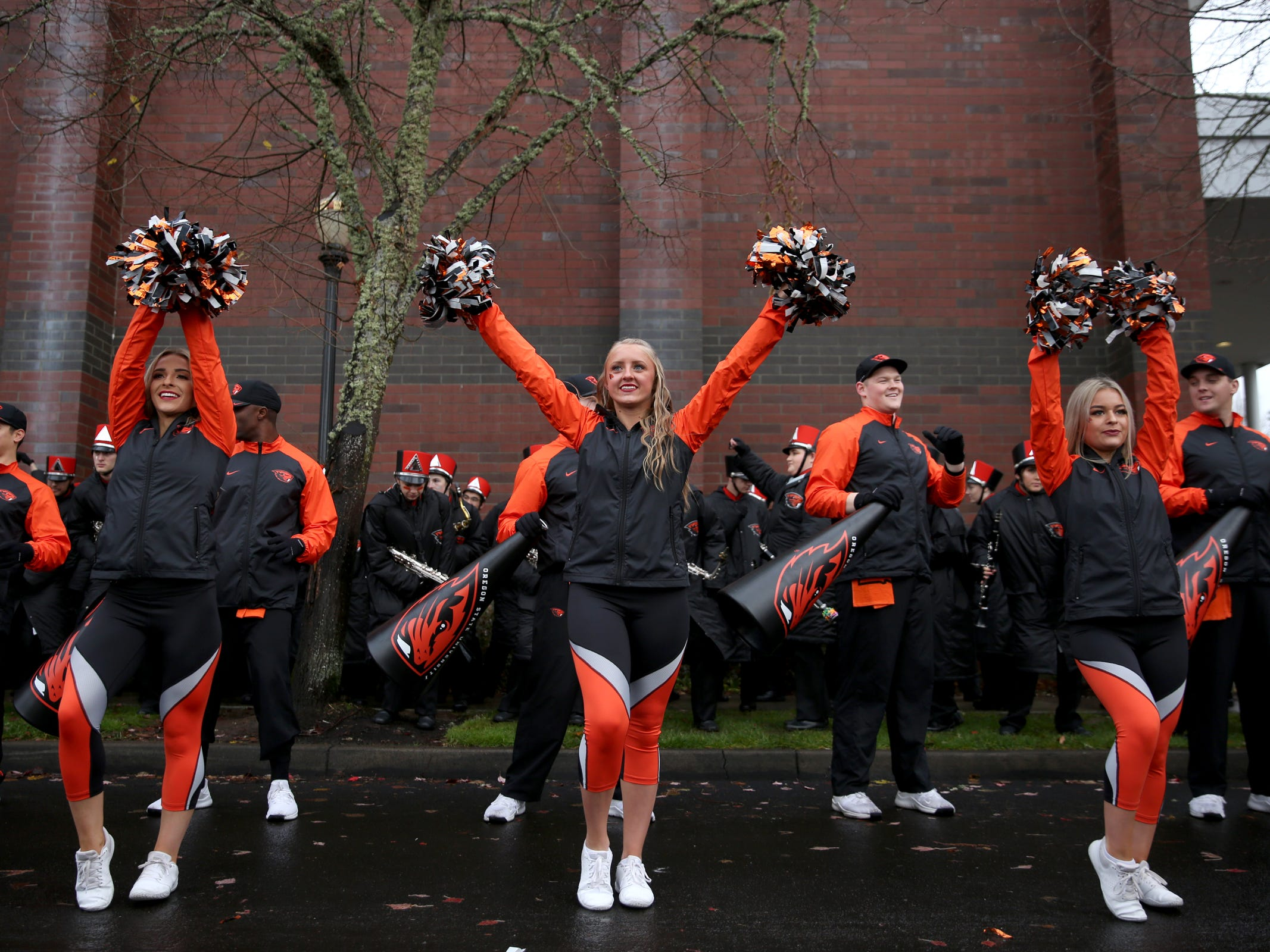 The Oregon State cheerleaders and marching band perform before the start of the Oregon vs. Oregon State Civil war football game at Oregon State University in Corvallis on Friday, Nov. 23, 2018.