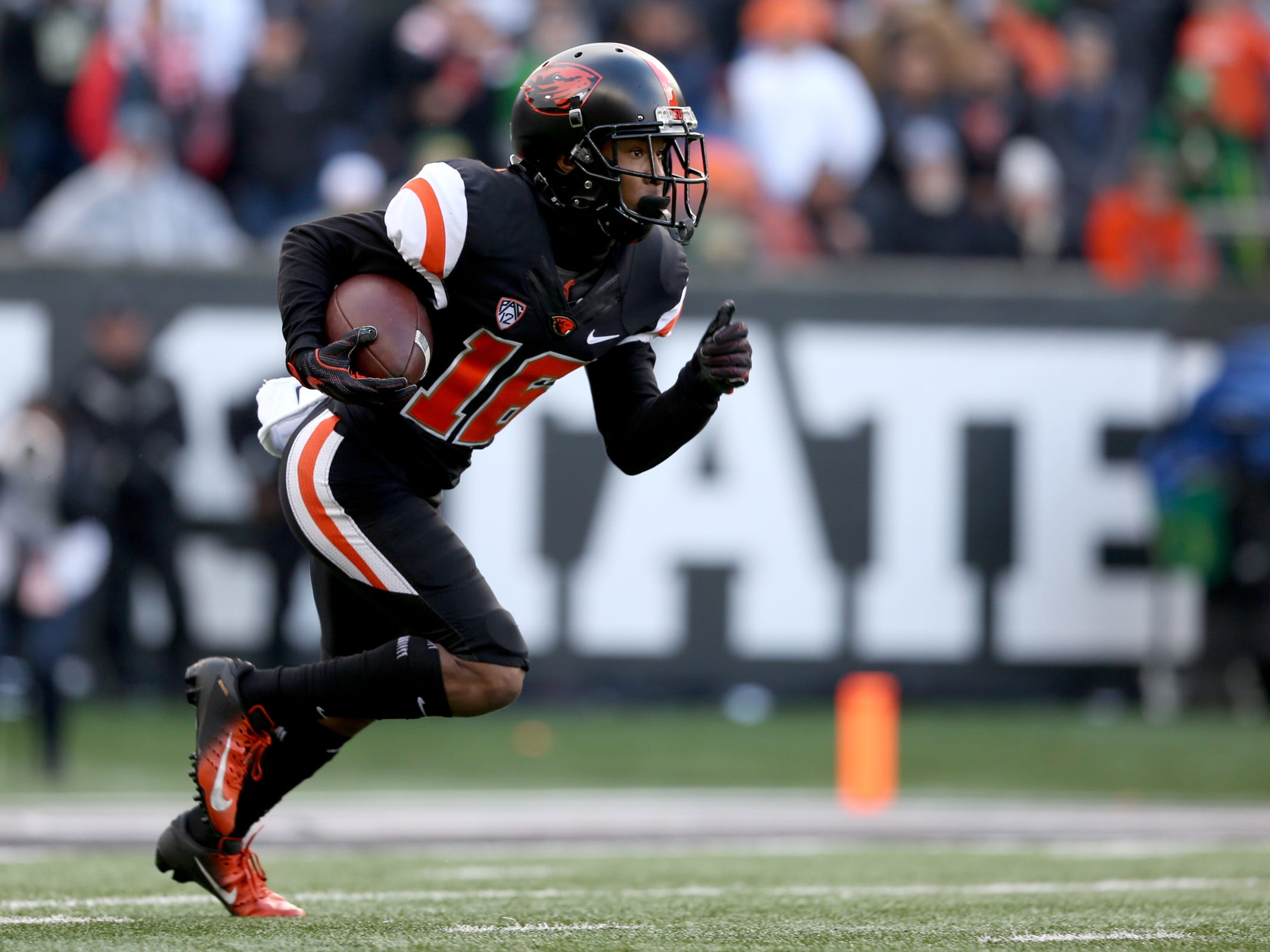 Oregon State's Champ Flemings (16) rushes in the Oregon vs. Oregon State Civil war football game at Oregon State University in Corvallis on Friday, Nov. 23, 2018.