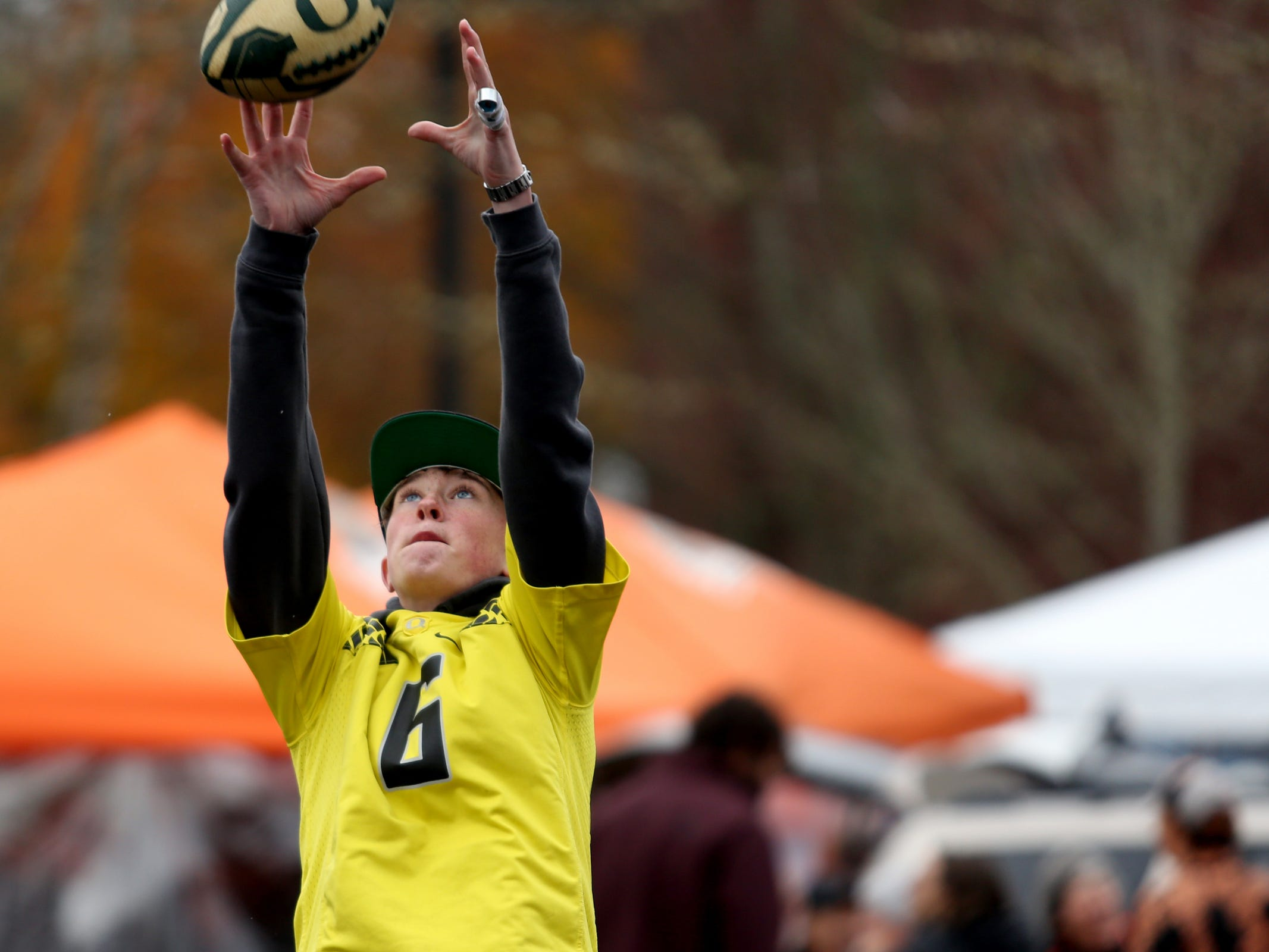 Landon Bottorff, 14, of Portland, plays catch before the start of the Oregon vs. Oregon State Civil war football game at Oregon State University in Corvallis on Friday, Nov. 23, 2018.