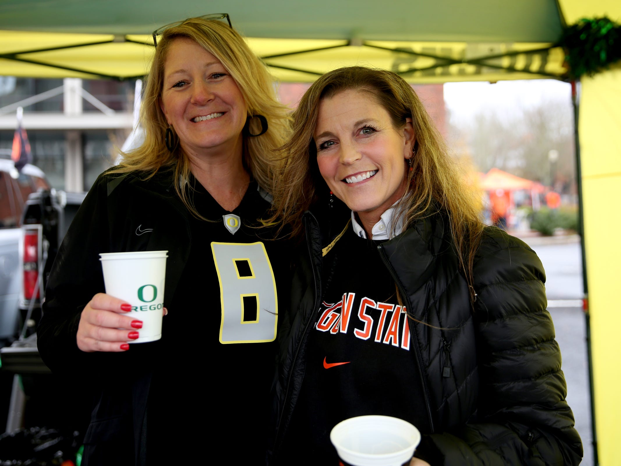 Sisters-in-law Darci Hansen, of Beaverton, and Lori Hansen, of Portland, before the start of the Oregon vs. Oregon State Civil war football game at Oregon State University in Corvallis on Friday, Nov. 23, 2018.