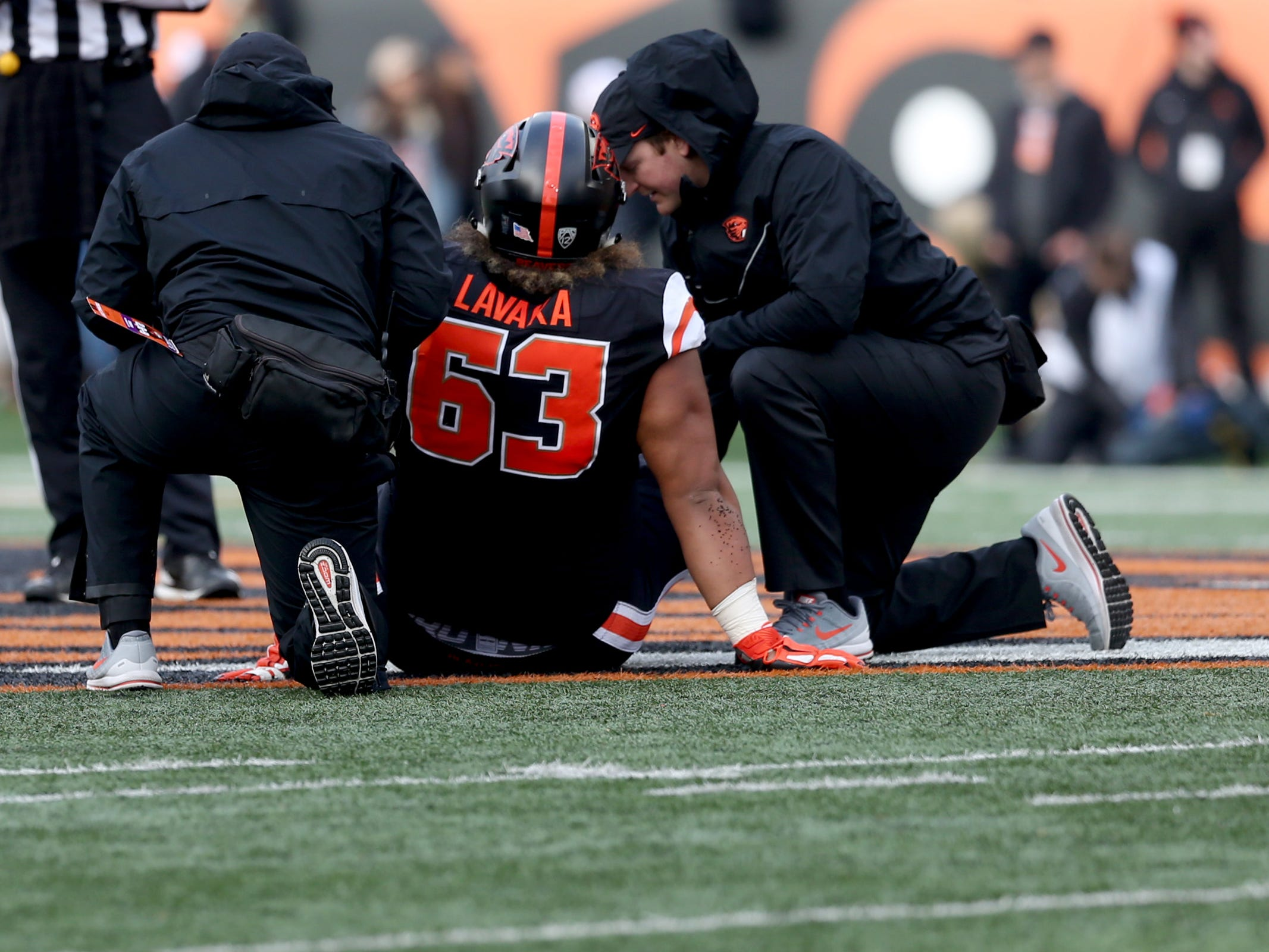 Oregon State's Gus Lavaka (63) is injured in the field in the Oregon vs. Oregon State Civil war football game at Oregon State University in Corvallis on Friday, Nov. 23, 2018.