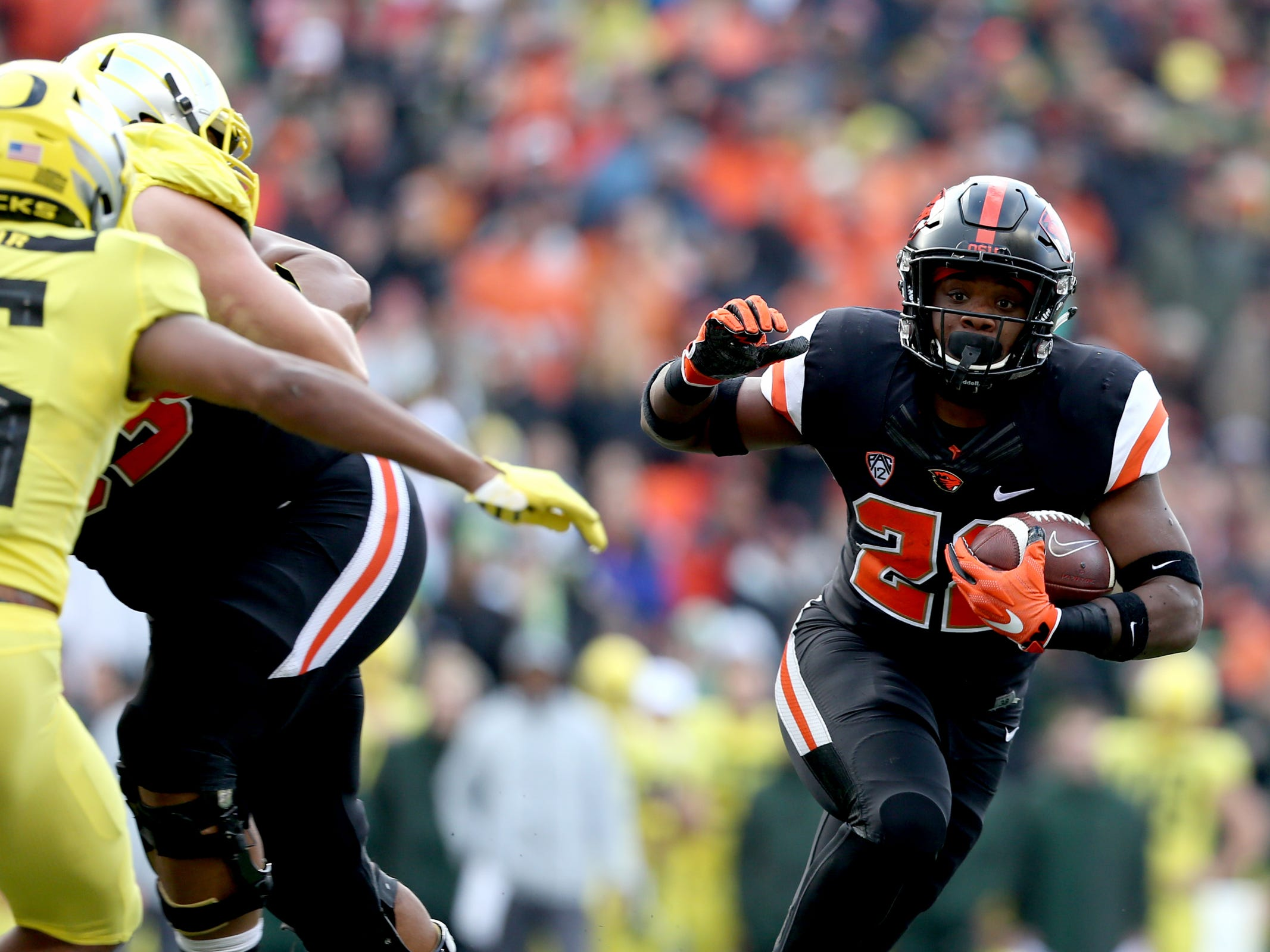 Oregon State's Jermar Jefferson (22) rushes in the Oregon vs. Oregon State Civil war football game at Oregon State University in Corvallis on Friday, Nov. 23, 2018.