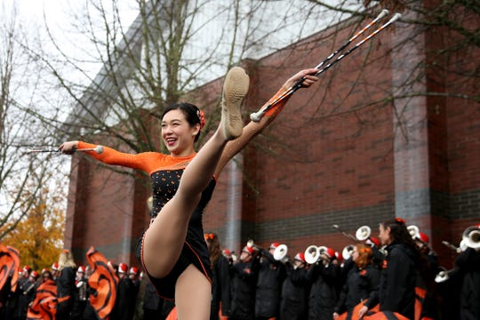 An Oregon State baton twirler performs before the start of the Oregon vs. Oregon State Civil war football game at Oregon State University in Corvallis on Friday, Nov. 23, 2018.