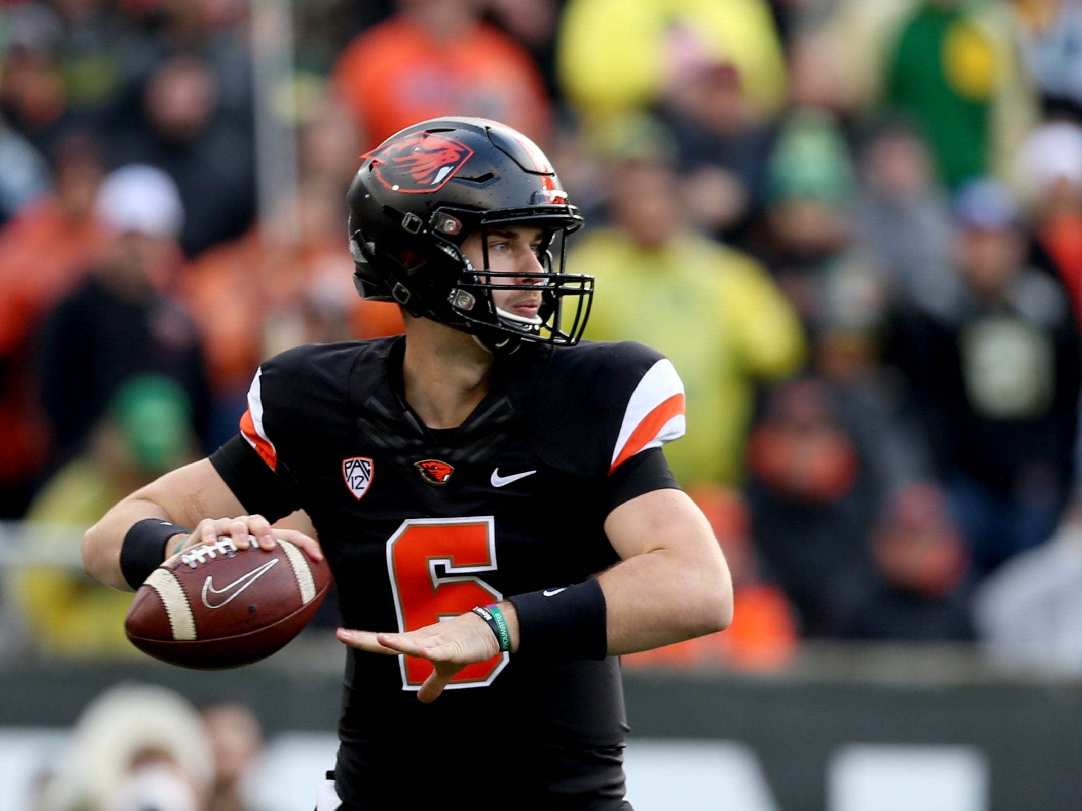 Oregon State's Jake Luton (6) looks to pass the ball in the Oregon vs. Oregon State Civil war football game at Oregon State University in Corvallis on Friday, Nov. 23, 2018.
