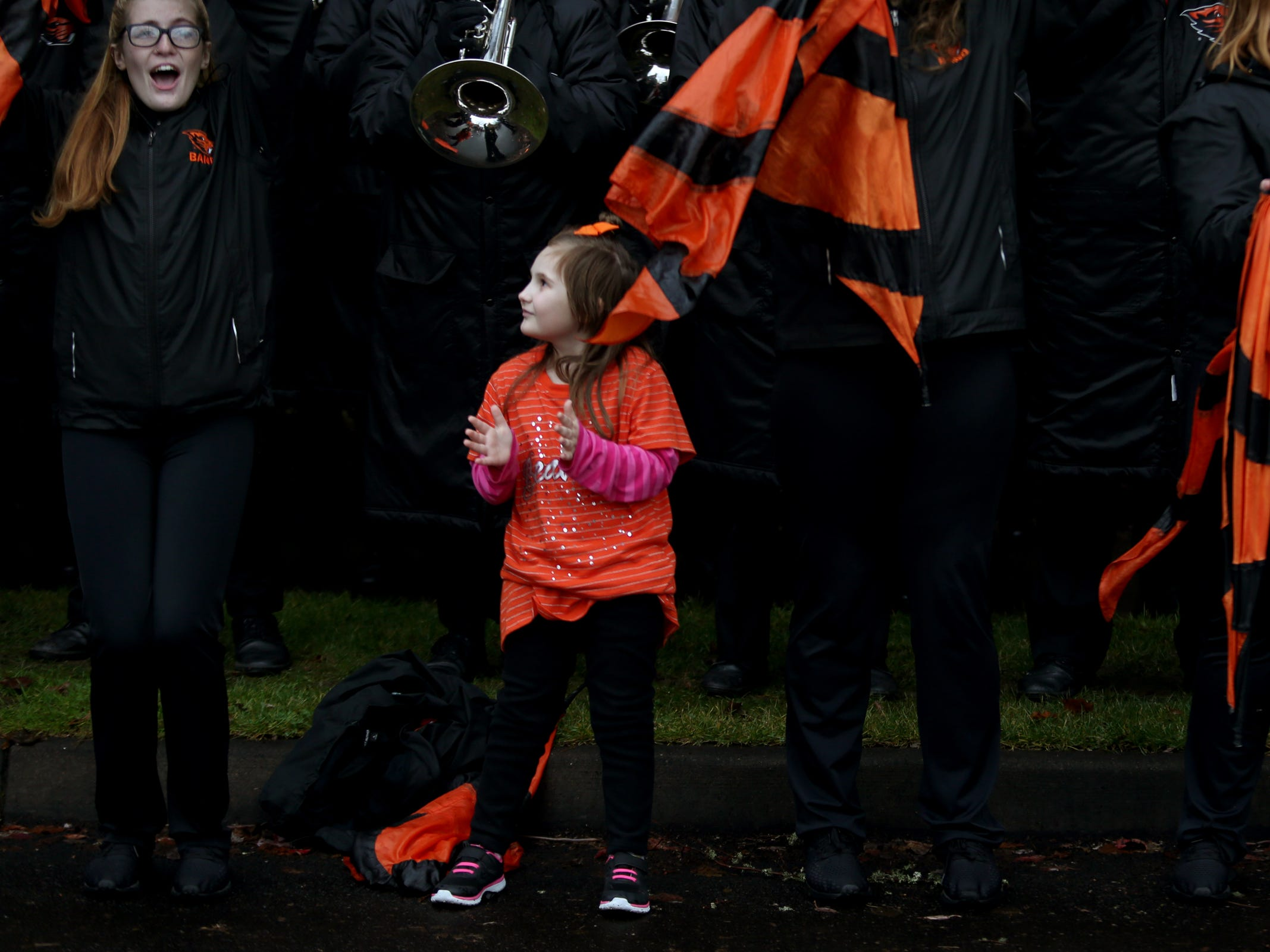 A girl stands with the Oregon State marching band before the start of the Oregon vs. Oregon State Civil war football game at Oregon State University in Corvallis on Friday, Nov. 23, 2018.