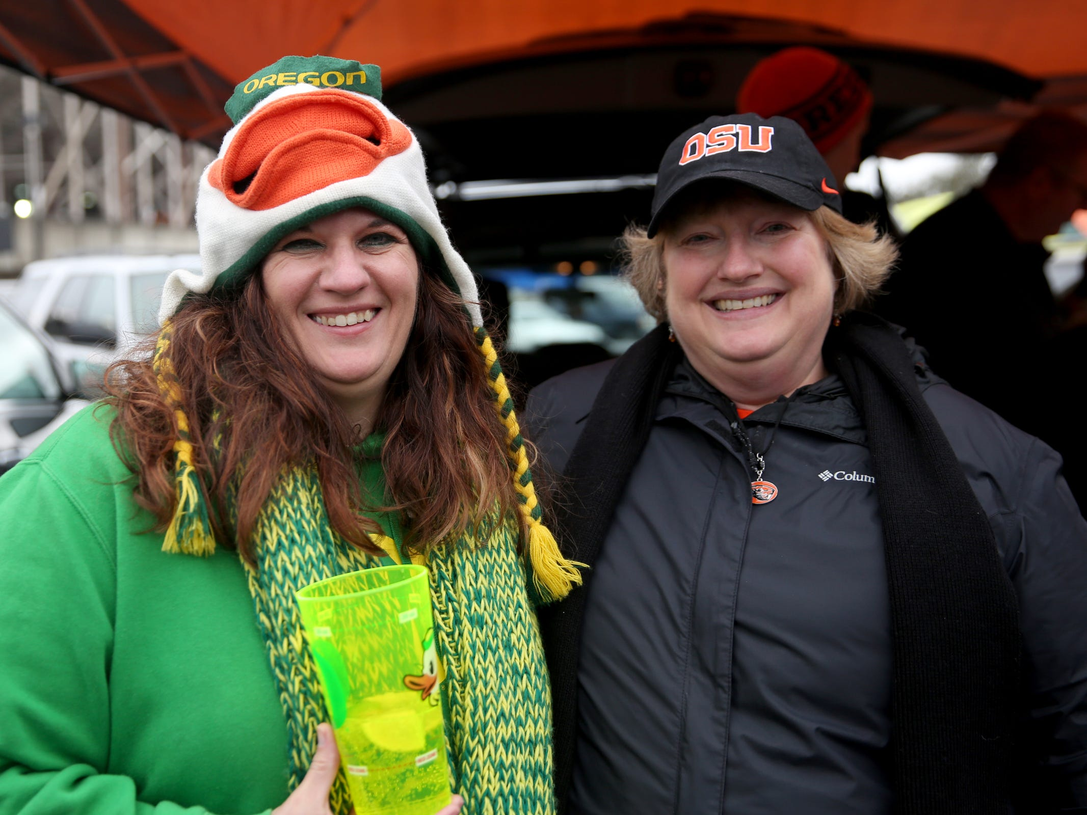 Sisters Anne Bruner, left, of Mt. Angel, and Sue Weber, of Tigard, root for different teams before the start of the Oregon vs. Oregon State Civil war football game at Oregon State University in Corvallis on Friday, Nov. 23, 2018.