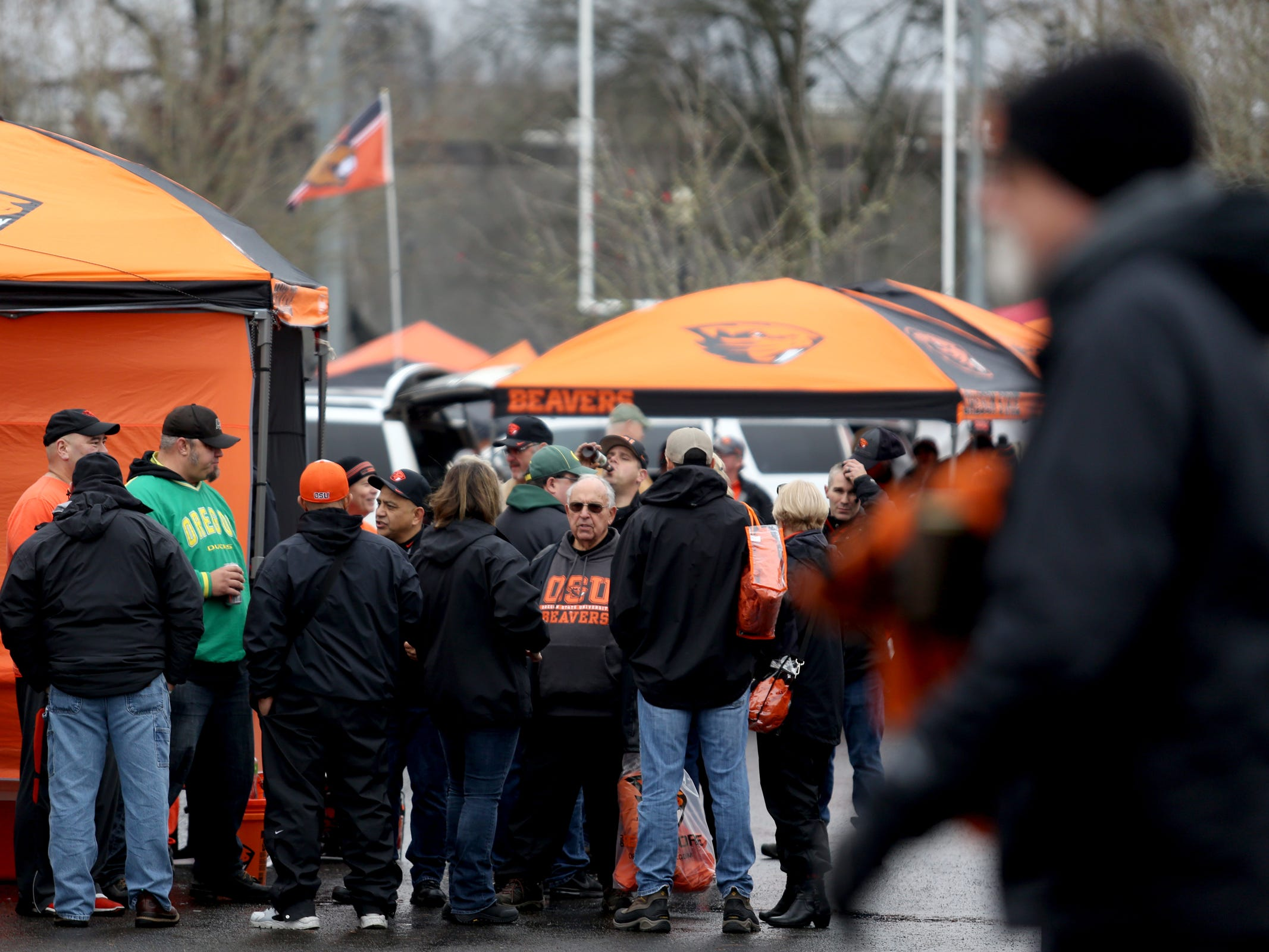 Oregon and Oregon State fans tailgate together before the start of the Oregon vs. Oregon State Civil war football game at Oregon State University in Corvallis on Friday, Nov. 23, 2018.
