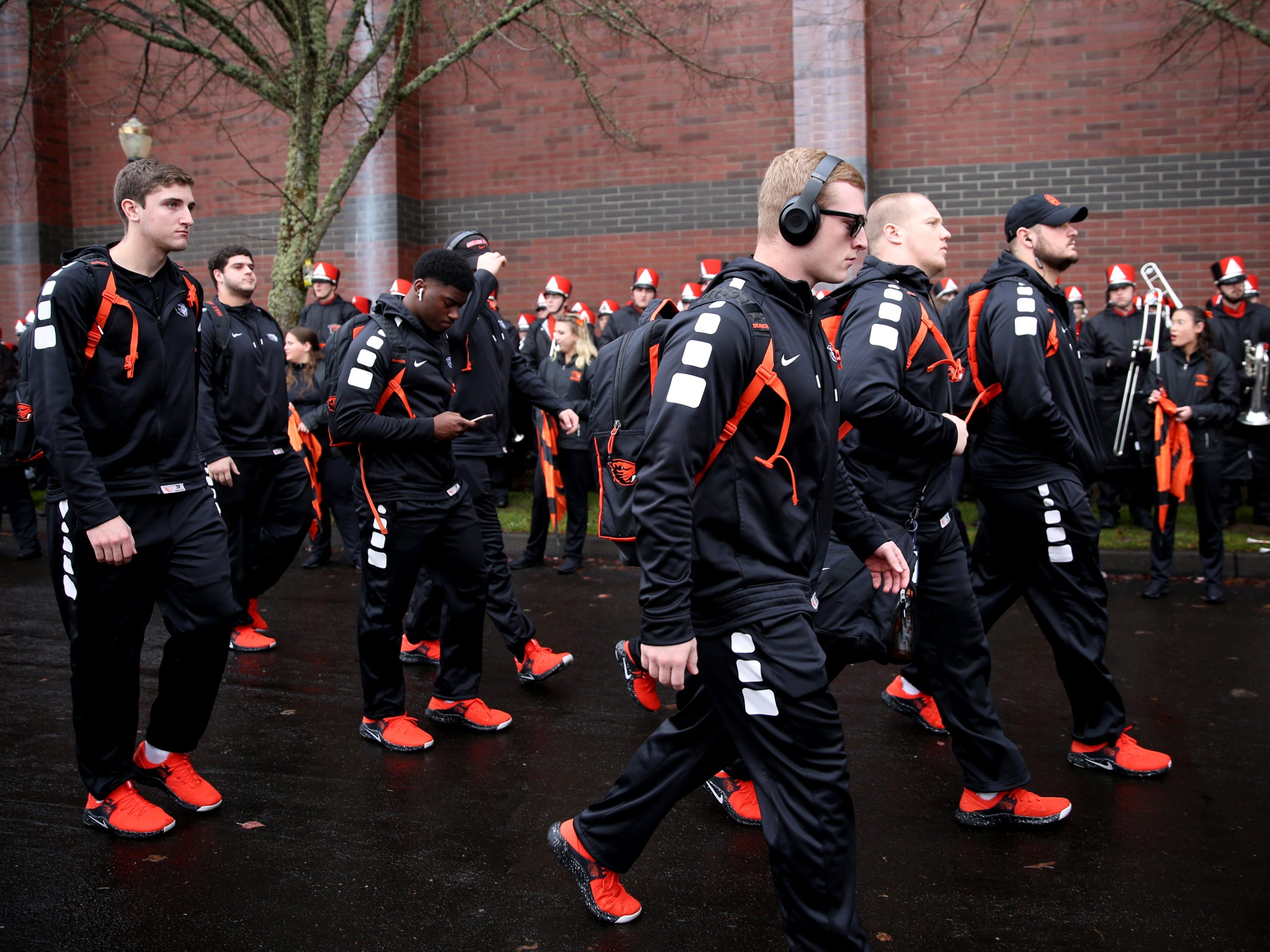 Oregon State players walk to the stadium before the start of the Oregon vs. Oregon State Civil war football game at Oregon State University in Corvallis on Friday, Nov. 23, 2018.