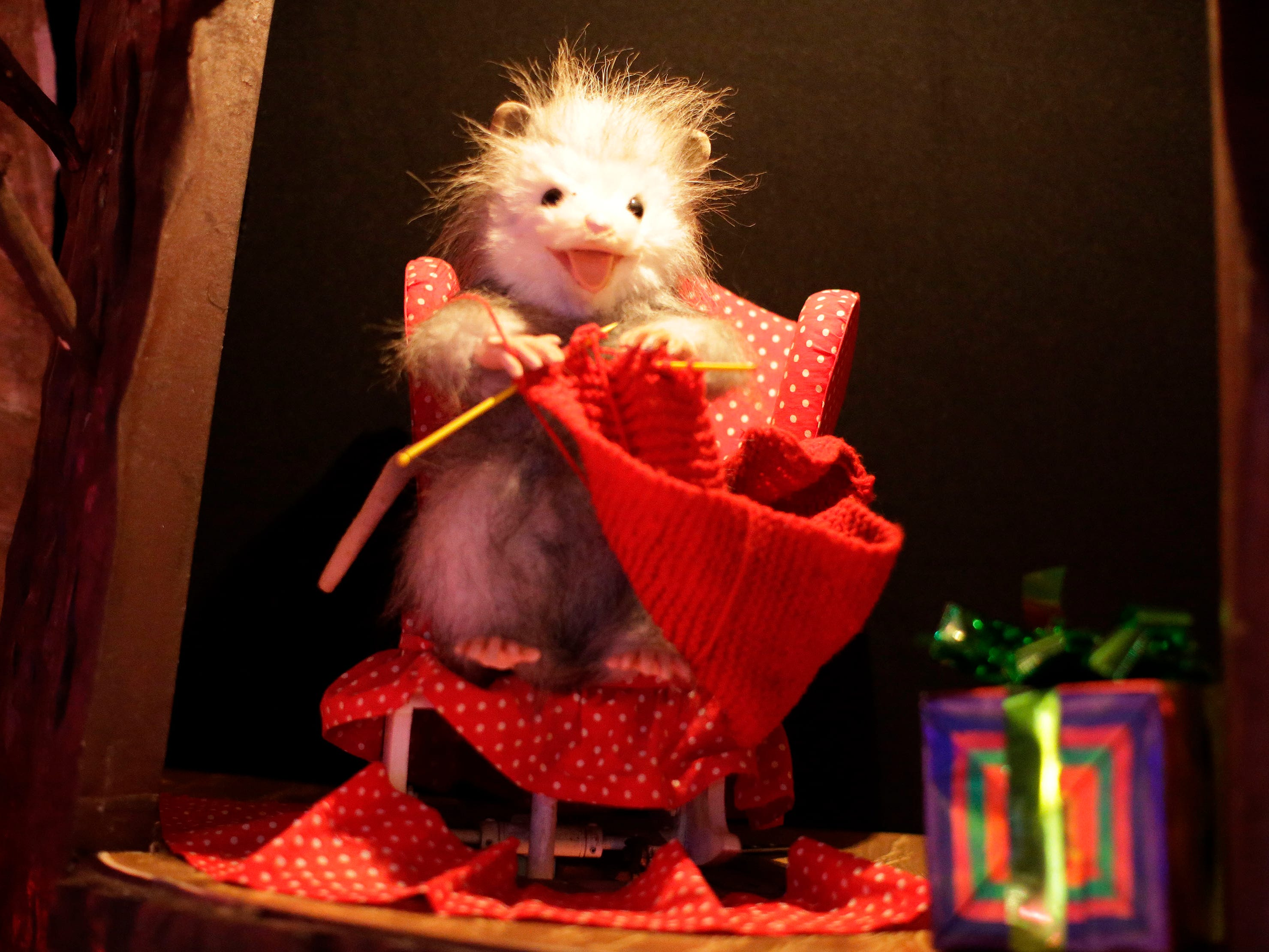 A possum knits up a sweater in an animation at the Sheboygan County Historical Museum's Holiday Memories, Friday, November 23, 2018, in Sheboygan, Wis.