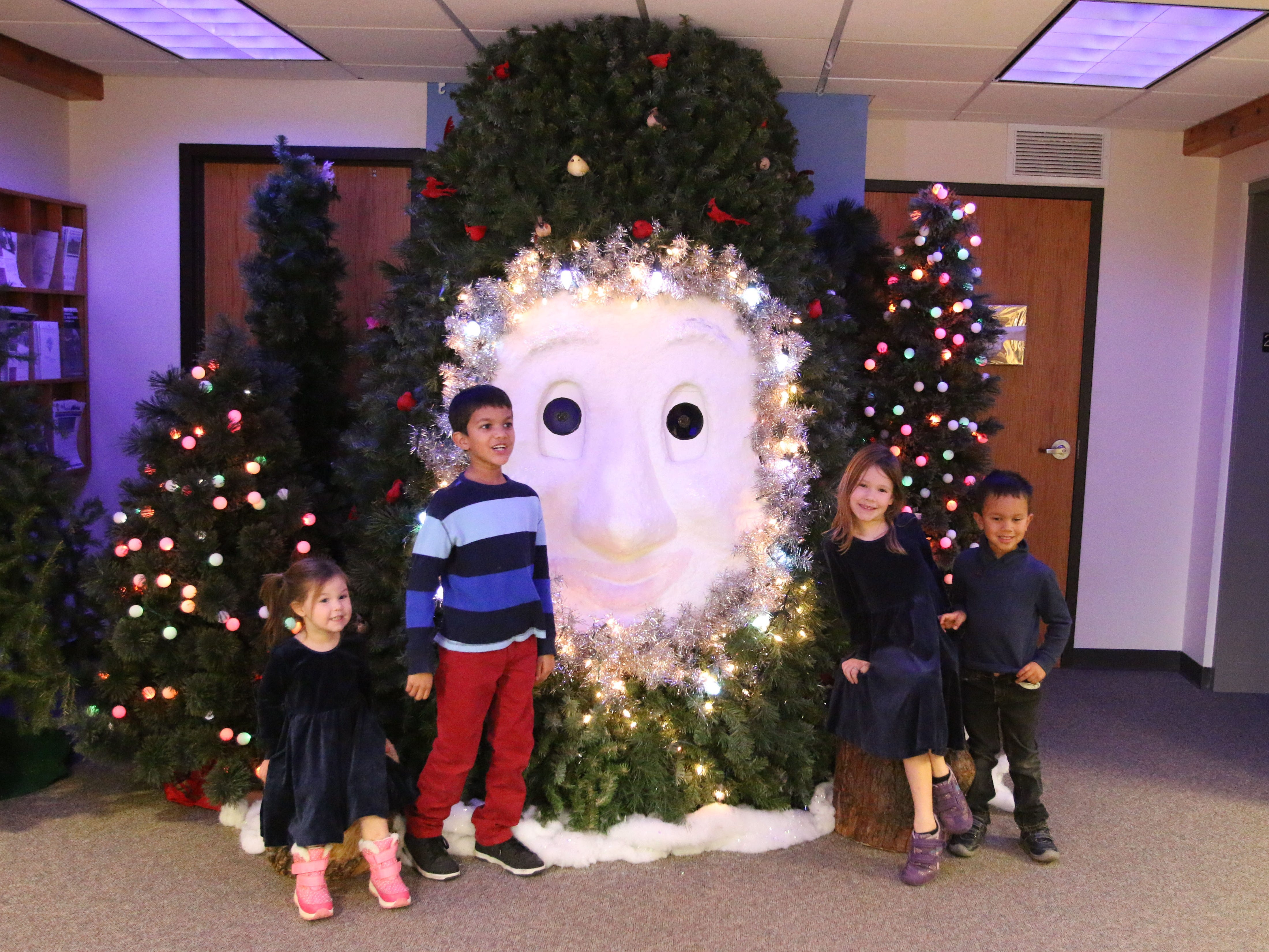 Children pose with Bruce the Spruce at the Sheboygan County Historical Museum's Holiday Memories, Friday, November 23, 2018, in Sheboygan, Wis.