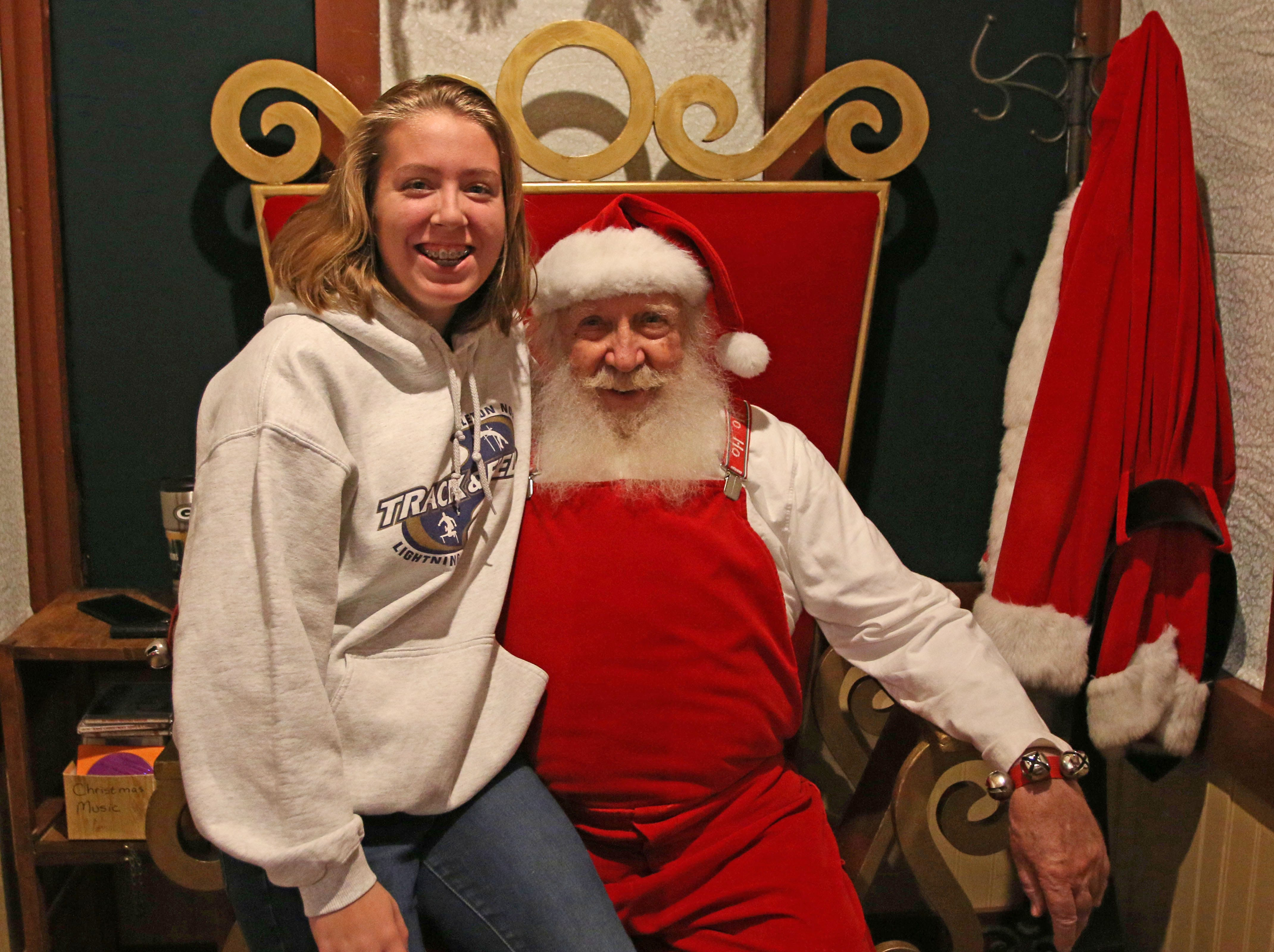 Ally Schipper, 15, of Appleton, Wis., poses with Santa Claus at the Sheboygan County Historical Museum's Holiday Memories, Friday, November 23, 2018, in Sheboygan, Wis. Santa will be at the show from time to time in the next weeks.