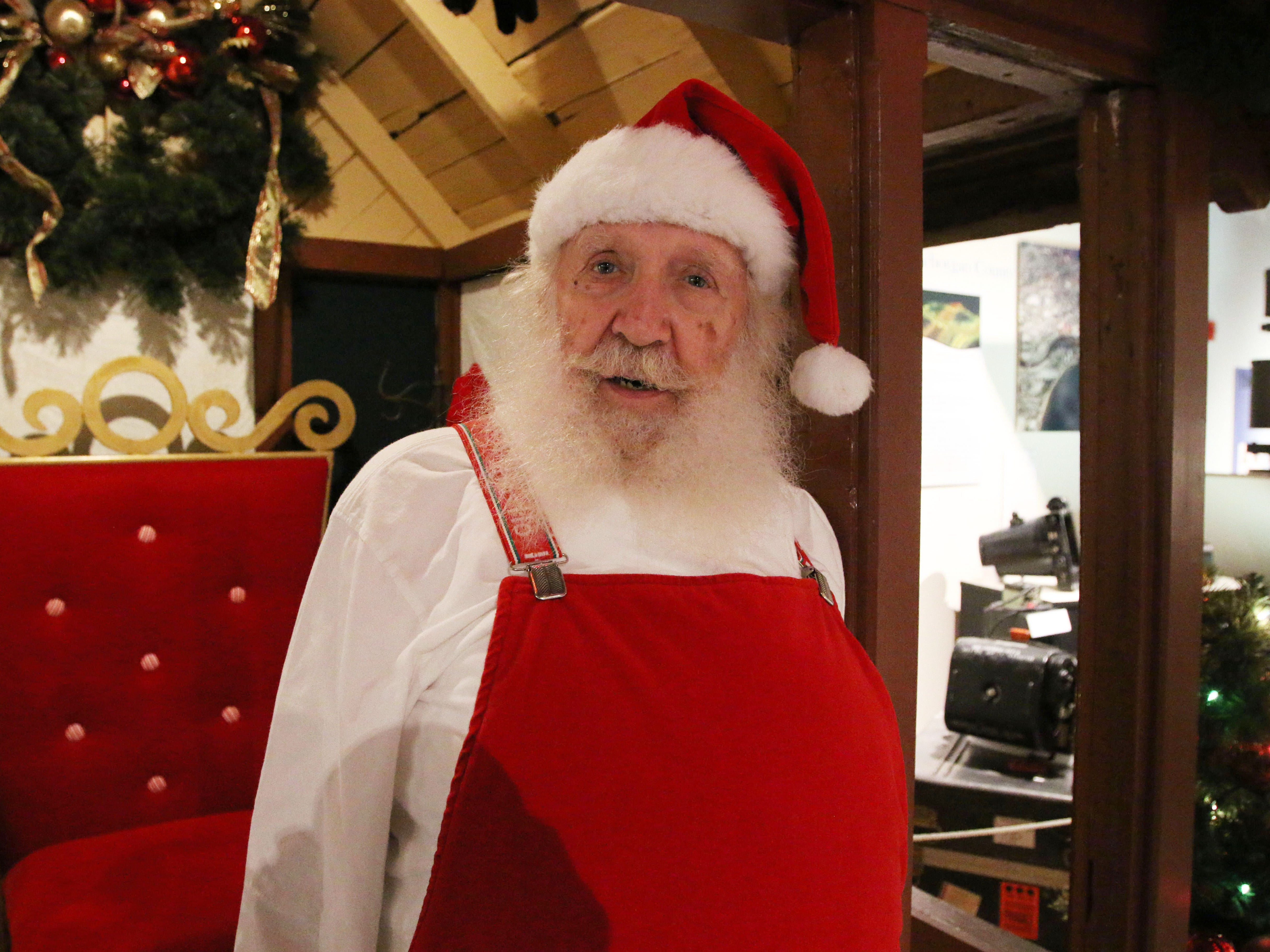Santa Claus poses at the Sheboygan County Historical Museum's Holiday Memories, Friday, November 23, 2018, in Sheboygan, Wis.  Santa will be there at times during the holiday to get those last minute requests in.
