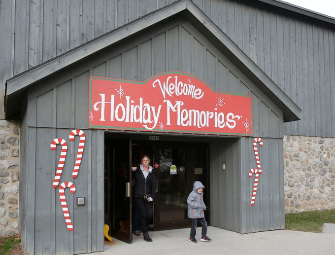 A family exits the Sheboygan County Historical Museum, Friday, November 23, 2018, in Sheboygan, Wis.  The museum opened its annual Holiday Memories display.