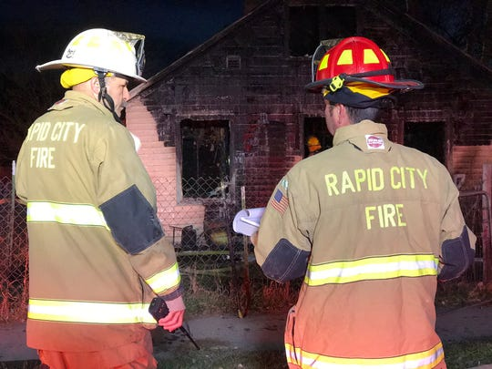 Crews from the Rapid City Fire Department respond to a structure fire Friday morning.