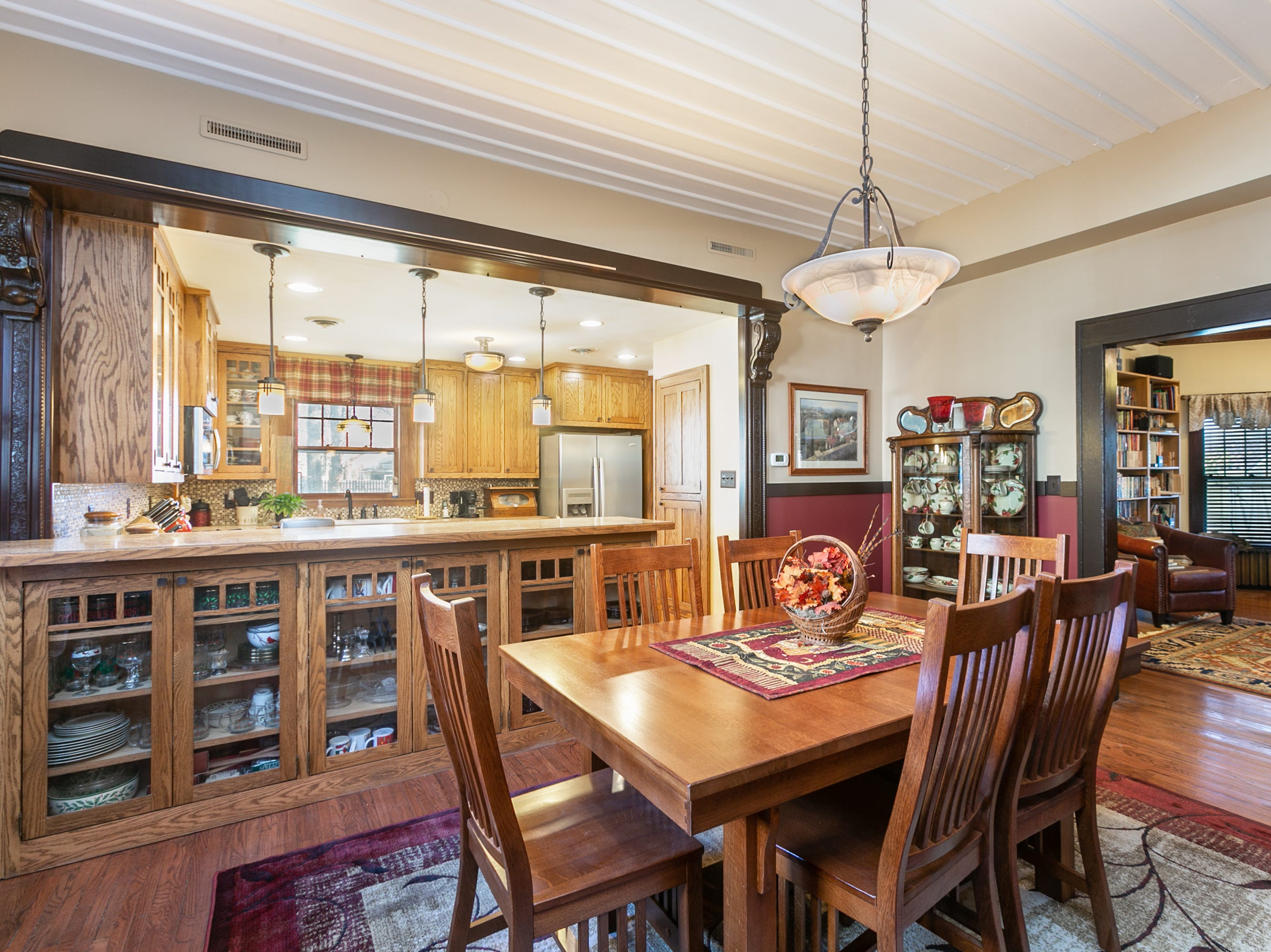 "The dining room is somewhat open to the kitchen, but nowhere near that of a modern ""open floor plan"" style. The home offers a nice flow for parties, from the living room, through library and dining room to kitchen The Springfield home of Cheryl Braswell on November 21, 2018."