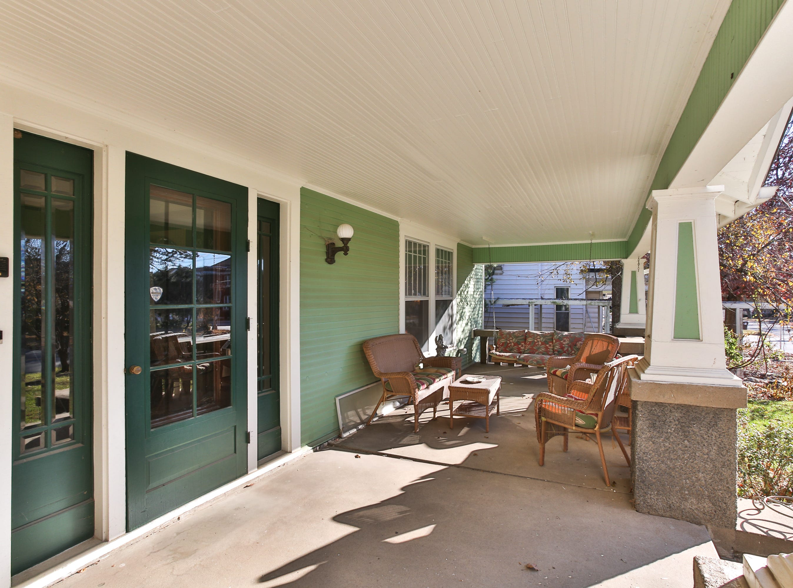 A wide, sun-filled porch greets guests to Cheryl Braswell's home in the heart of Springfield.