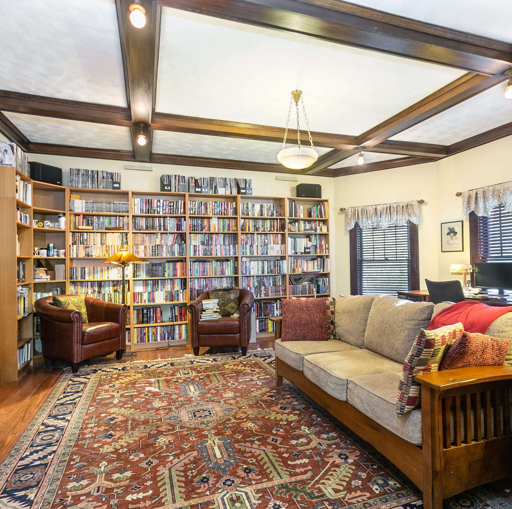 Midtown home's owner fell in love with library, leaded glass