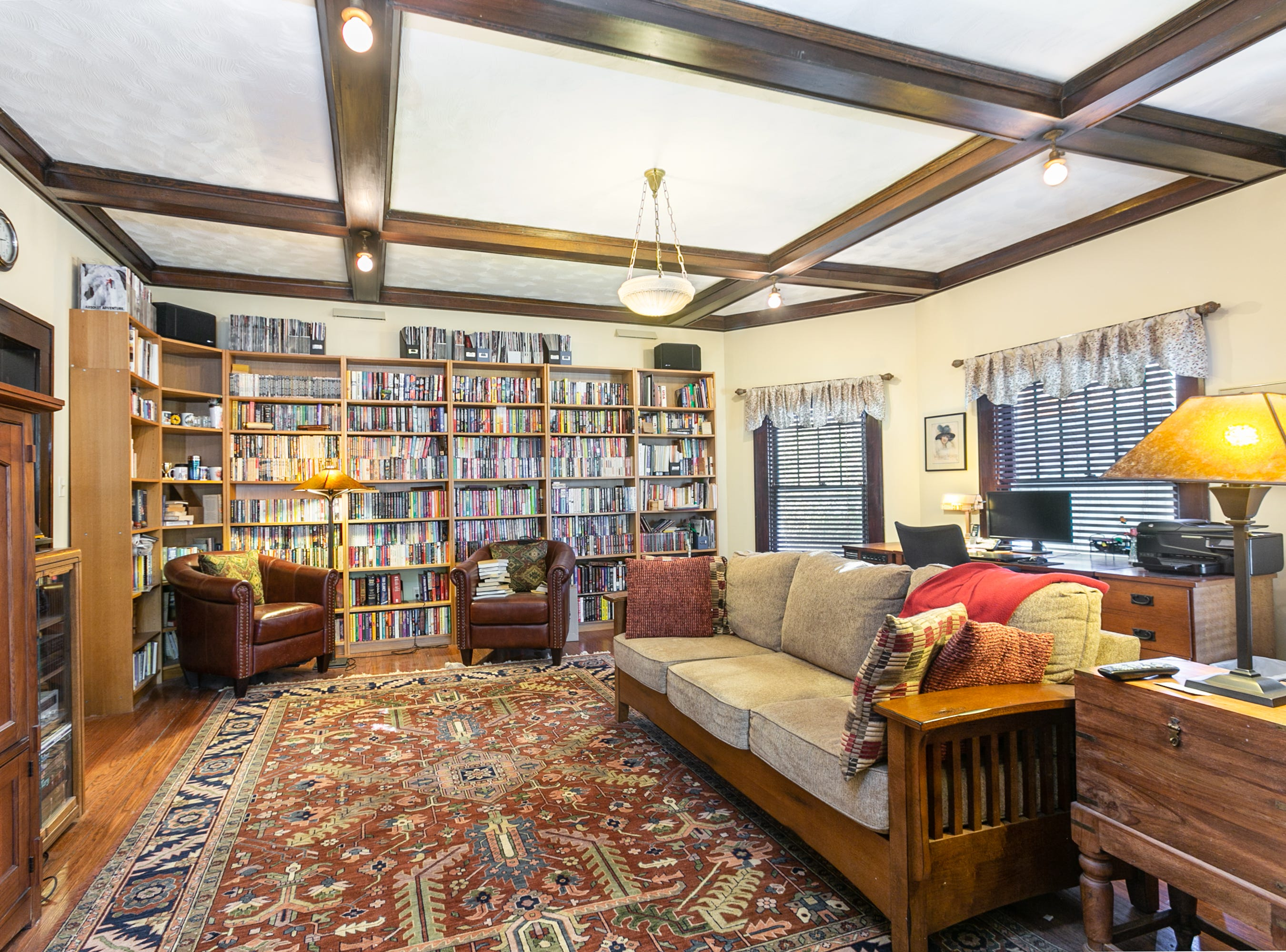 The library's coffered ceiling was one of two elements that initially drew Cheryl Braswell to the home. The other was leaded glass on interior doors.