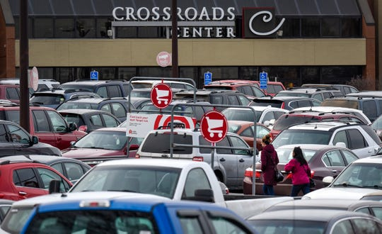 The parking lot is full of cars in front of the Crossroads Center entrance near Target Friday, Nov. 23, in St. Cloud.