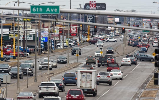Traffic moves slowly along Division Street Friday, Nov. 23, in Waite Park.