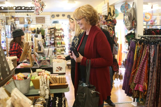 Susan Schab finds a gift for her parents at Quarter Moon on Black Friday, Nov. 23, 2018.