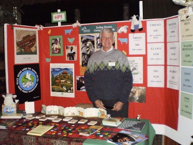 John Davis, founder of the Alternative Market at John Wesley United Methodist Church, at one of the booths.