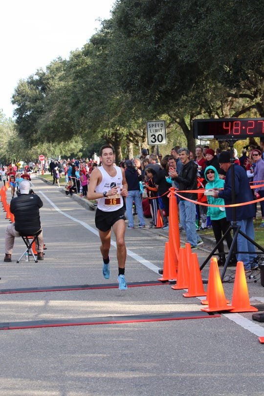 Former FSU and Wakulla High runner Stanley Linton captured the Turkey Trot 15K Thursday morning in Southwood.