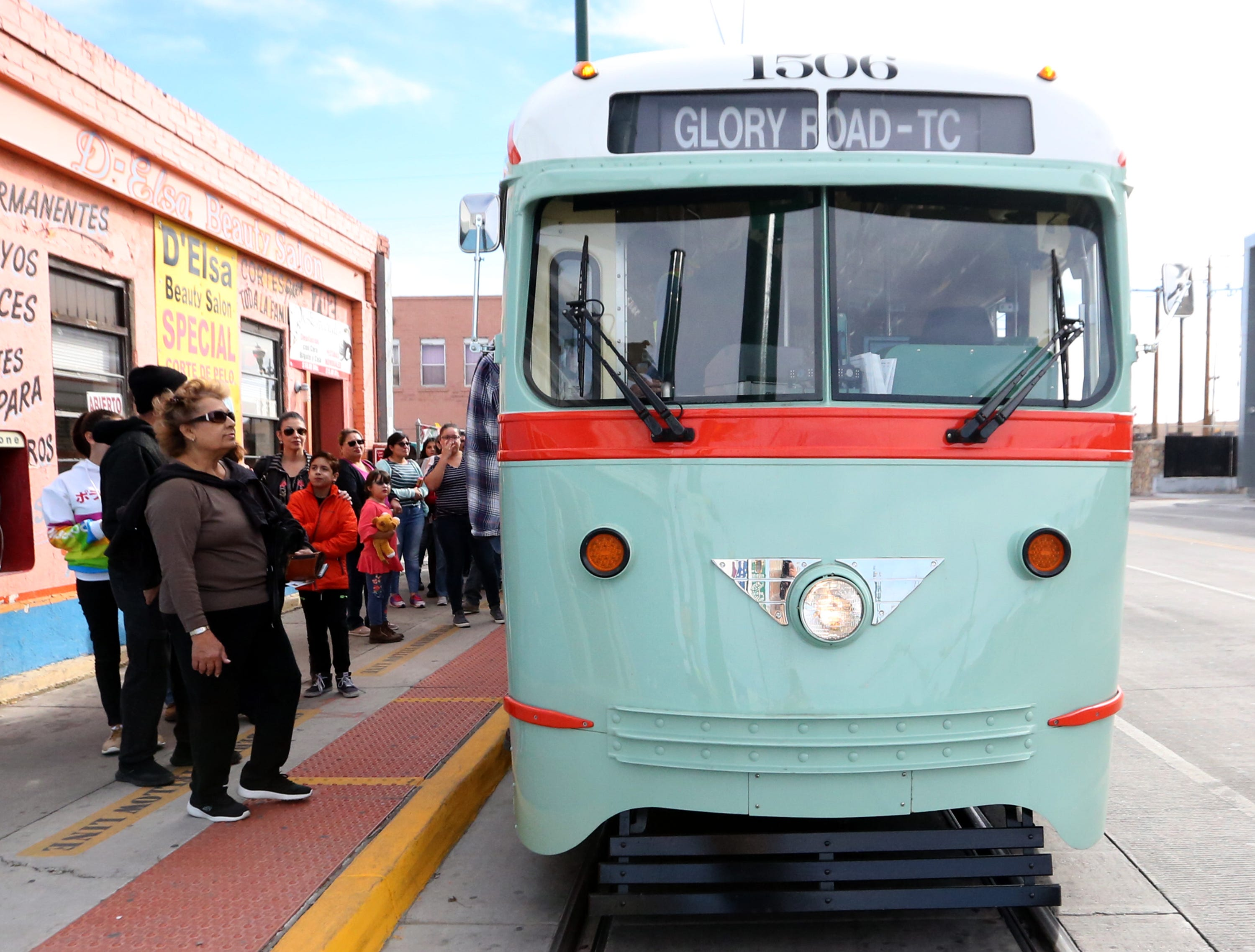 Passengers line up to board streetcar 1506 during one of its stops along Santa Fe Street Friday in South El Paso.
