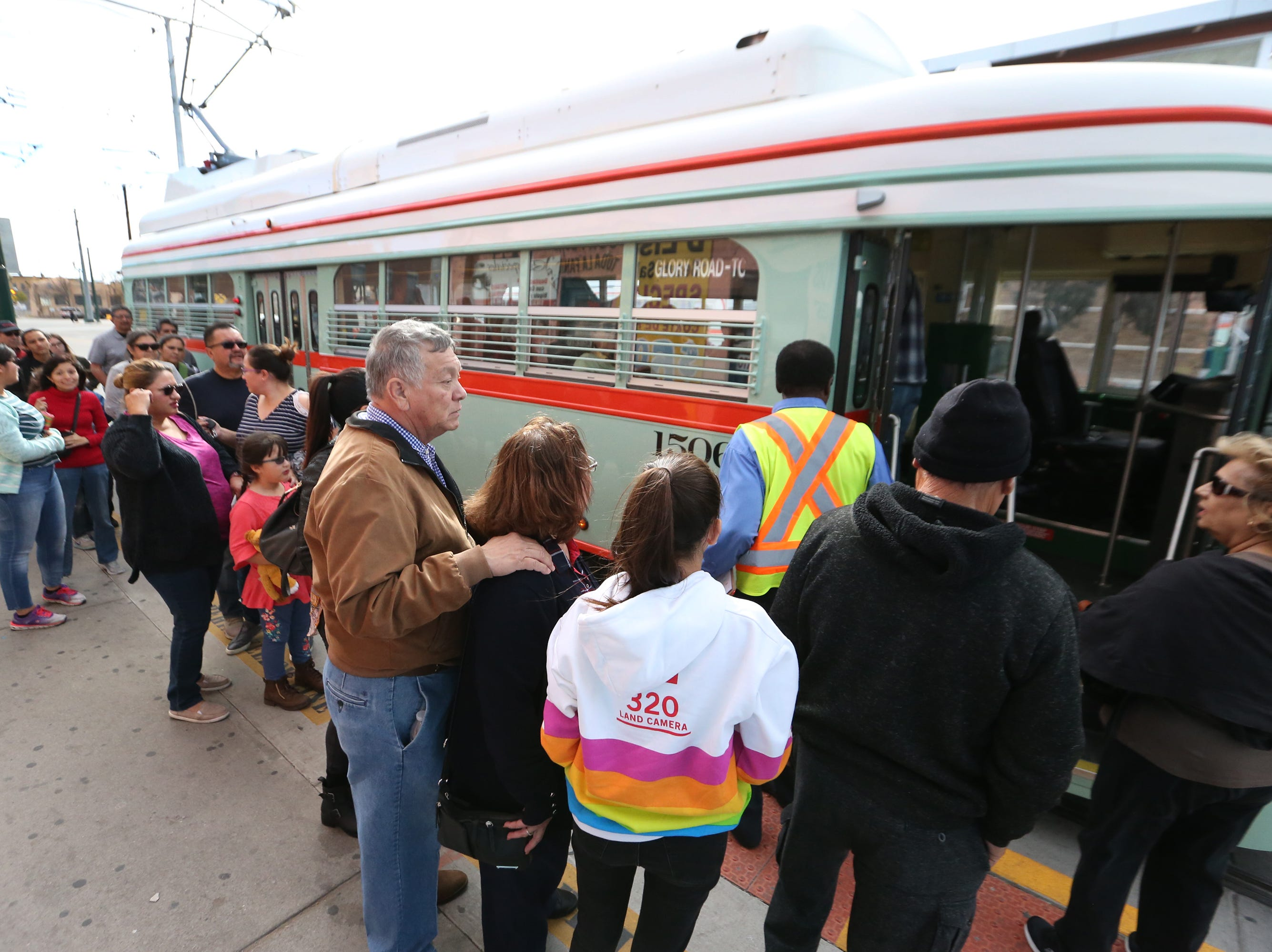 People line up to ride Streetcar 1506, one of five refurbished streetcars along Santa Fe Street Friday in South El Paso. A sixth streetcar may arrive next month, a streetcar operator said.