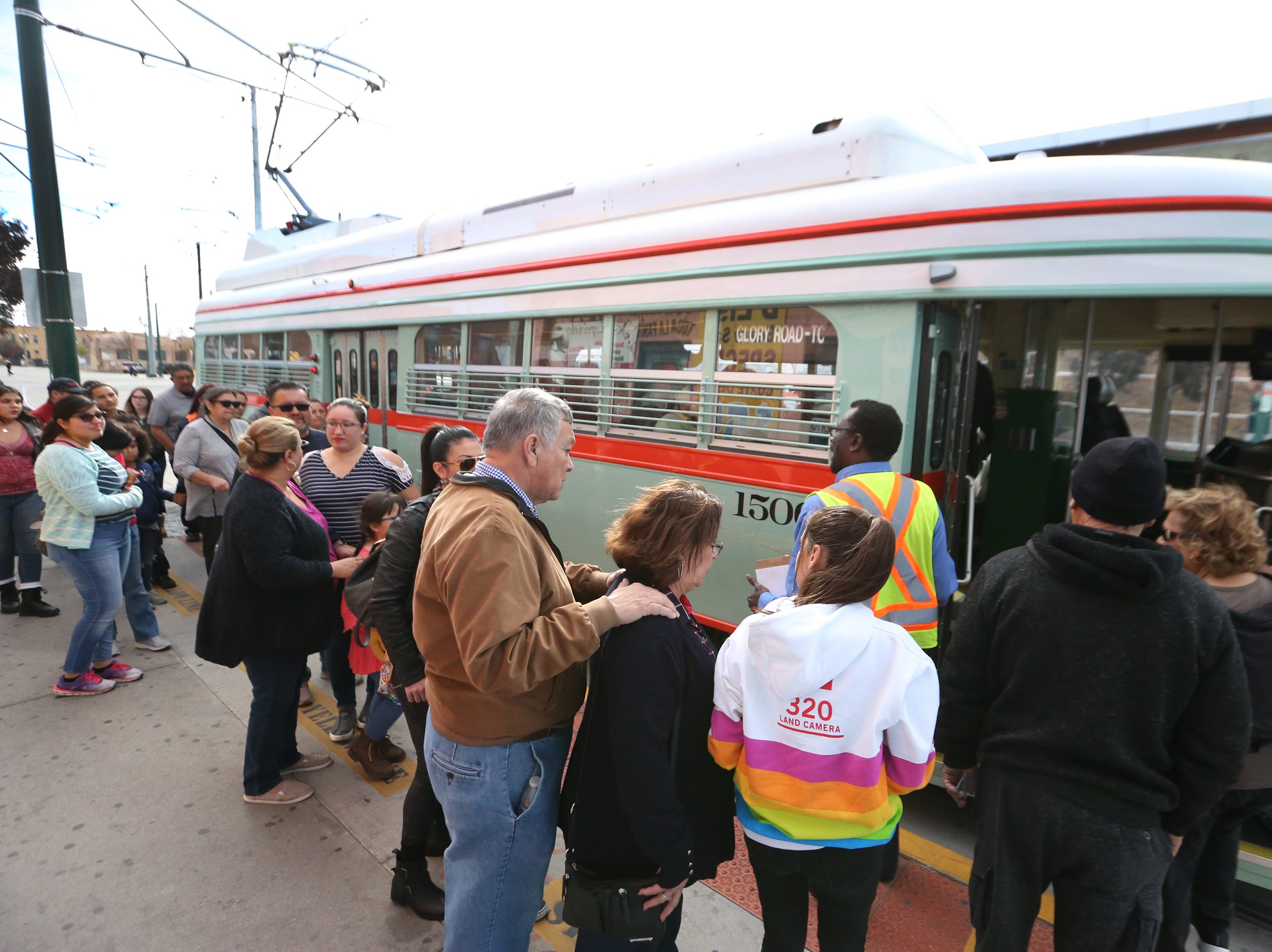 People line up to hop into streetcar 1506 along Santa Fe Street Friday.