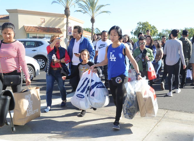 Shoppers flock to the Camarillo Premium Outlets to check out the sales on Black Friday.