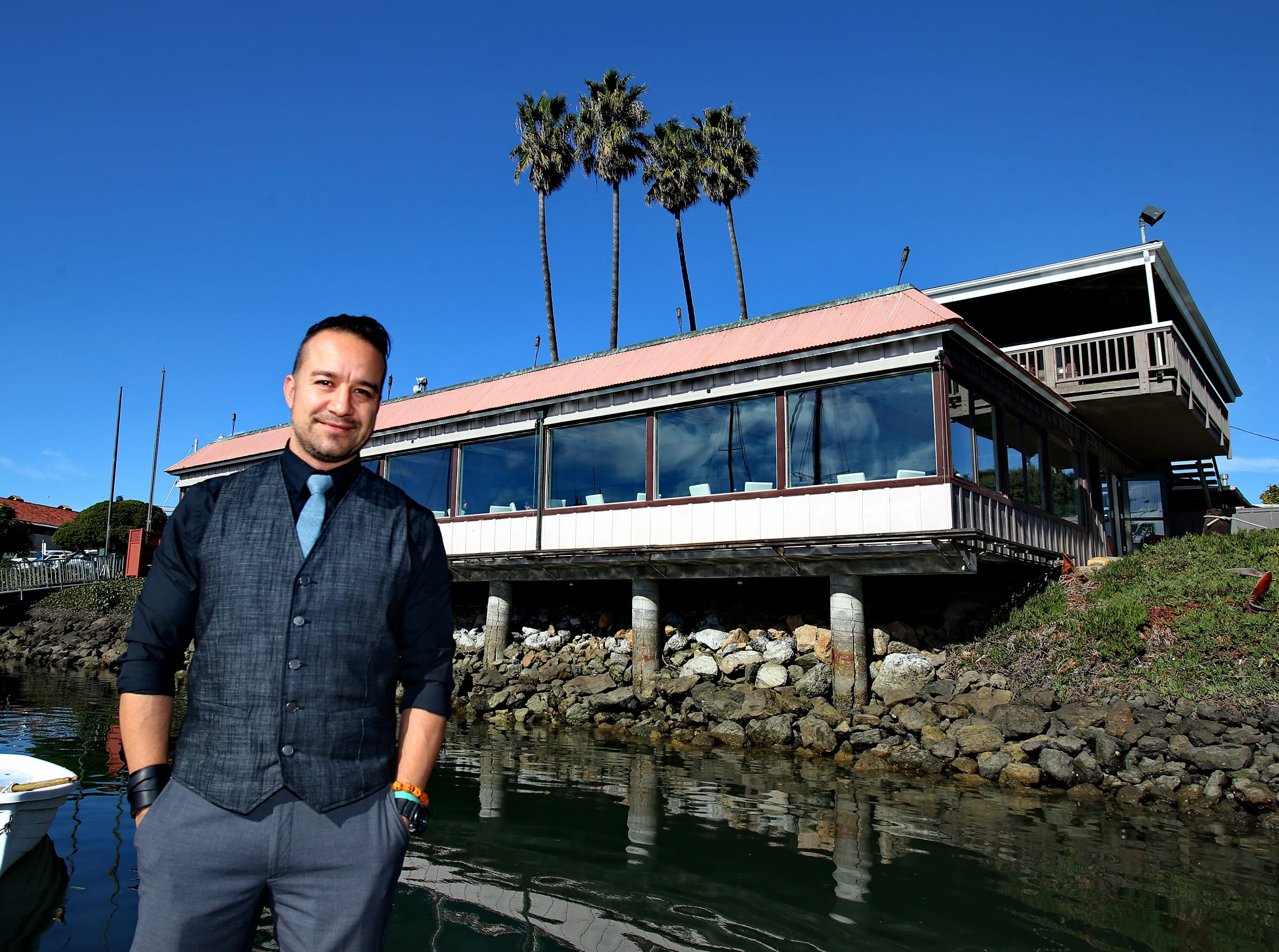 Water's Edge Restaurant and Bar's marketing director Misa Silva stands in front of the restaurant's main dining area that overlooks the Ventura Harbor. The new restaurant is at 1510 Anchors Way Drive in Ventura.