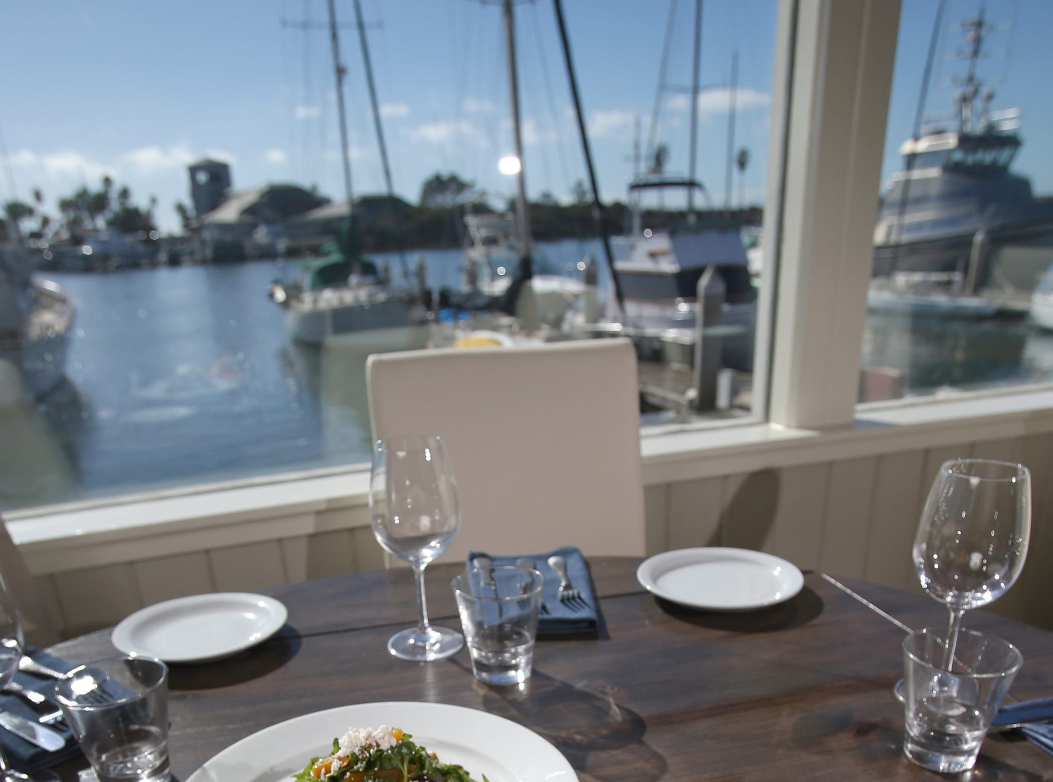 Water's Edge Restaurant and Bar is Ventura Harbor's newest waterfront restaurant. Pictures is its Mediterranean-Style Lobster Tail and Red and White Salad.