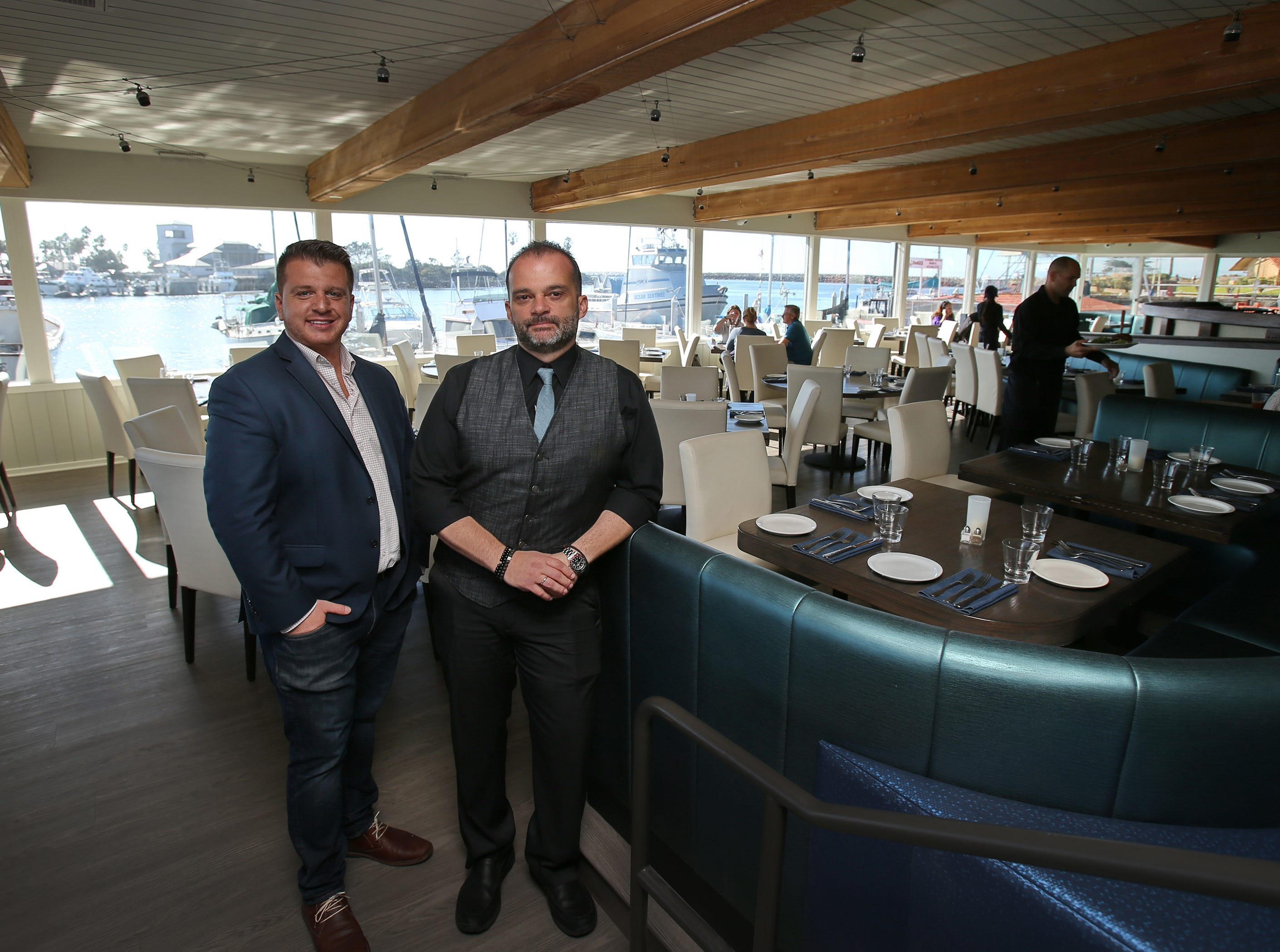 Water's Edge Restaurant and Bar's General Manager Tony Dybeku and Director of Operations Orestis Simos stand in the main dining area of their new restaurant at the Ventura Harbor.