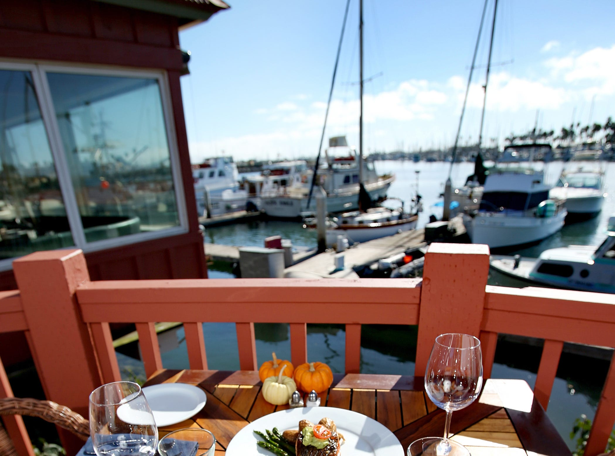 Water's Edge Restaurant and Bar is Ventura Harbor's newest waterfront restaurant. Pictured is its Chipotle Orange-Glazed Pork Chop (left to right), Mediterranean-Style Lobster Tail and Crispy Skinned Salmon.