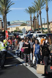Crossing guards were needed at the Camarillo Premium Outlets to handle crowds on Black Friday.