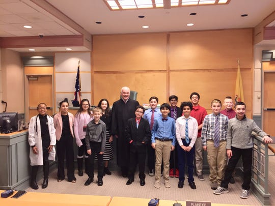 Cumberland County Superior Court Judge Harold U. Johnson (center) hosted students from Veterans Memorial Middle School in Vineland. Johnson also visited the school to talk with fifth and sixth graders as part of the court system's 'Classroom to Courtroom' program.