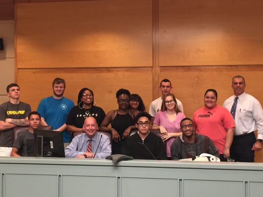 Millville high school students visited this year with Judge Robert Malestein (from row, 2nd from left) in his courtroom in Bridgeton as part of the 'Classroom to Courtroom' outreach program.
