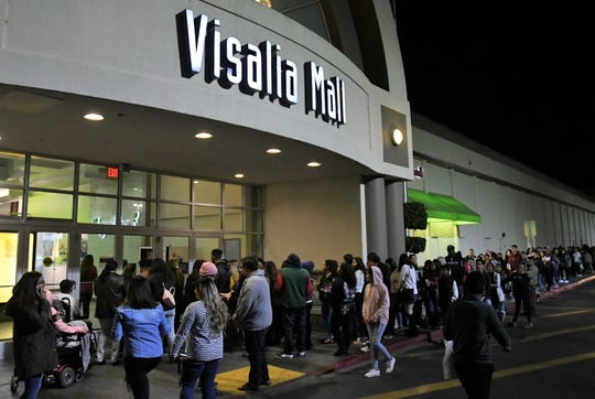 Eager holiday shoppers gathered in front of The Visalia Mall on Thanksgiving before its 6 p.m. opening.