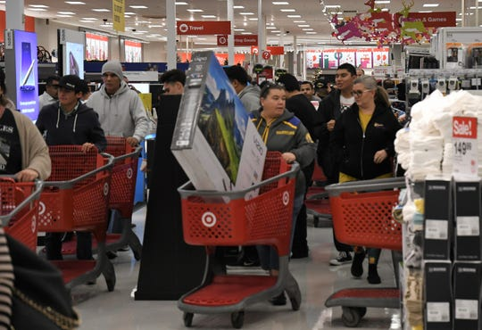 Deals on TVs, video games and other electronics motivated shoppers to hit stores early this Black Friday season, according to Target employees.